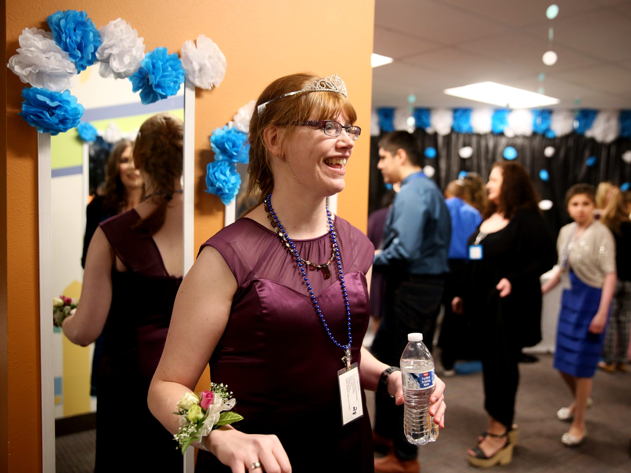 Kris Burden, 36, of Salem, arrives at Night to Shine, a prom night experience for people with special needs, at Salem Alliance Church on Friday, Feb. 8, 2019.