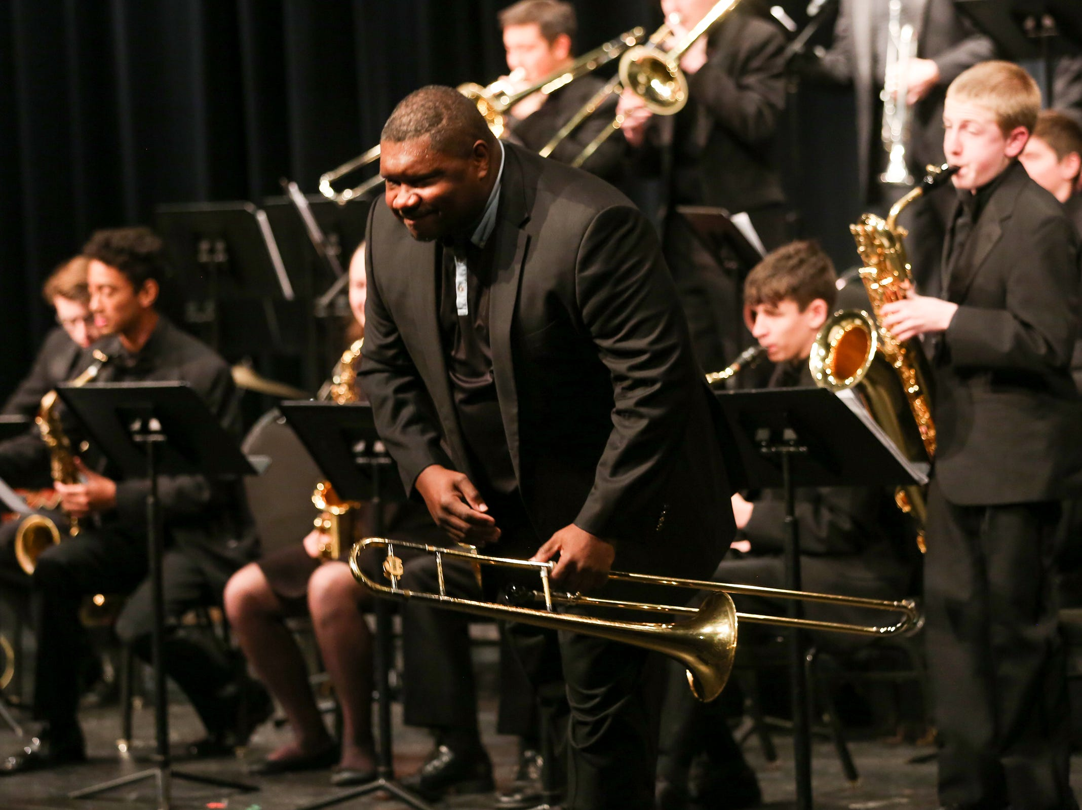 Jazz trombonist Wycliffe A. Gordon takes a bow while he performs with West Salem High School students at the annual West Salem Jazz Festival at West Salem High School on Saturday, Feb. 9, 2019.