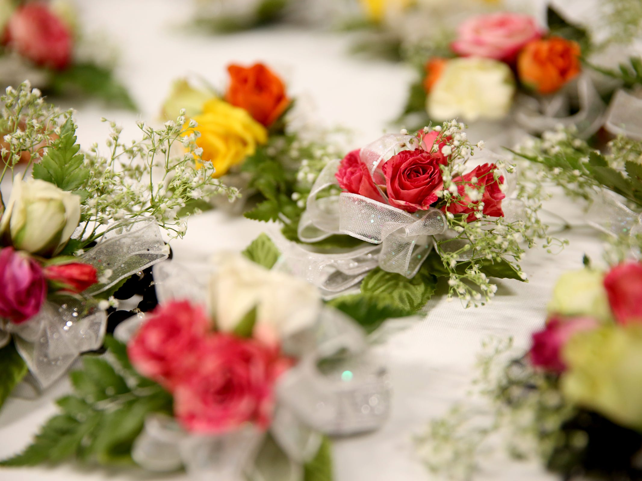 Corsages and boutonnieres are given out to attendees at Night to Shine, a prom night experience for people with special needs, at Salem Alliance Church on Friday, Feb. 8, 2019.