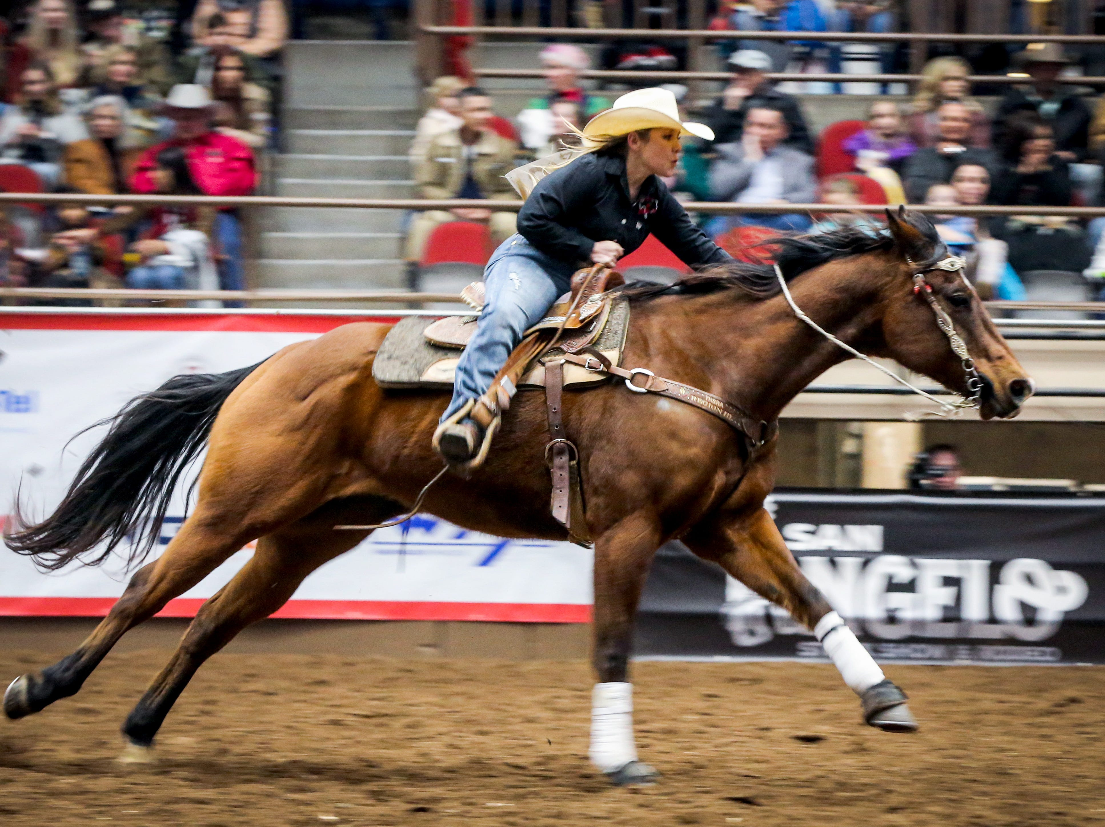 Shaylee Hindman races barrels during the San Angelo Stock Show & Rodeo matinee show Saturday, Feb. 9, 2019, at Foster Communications Coliseum.