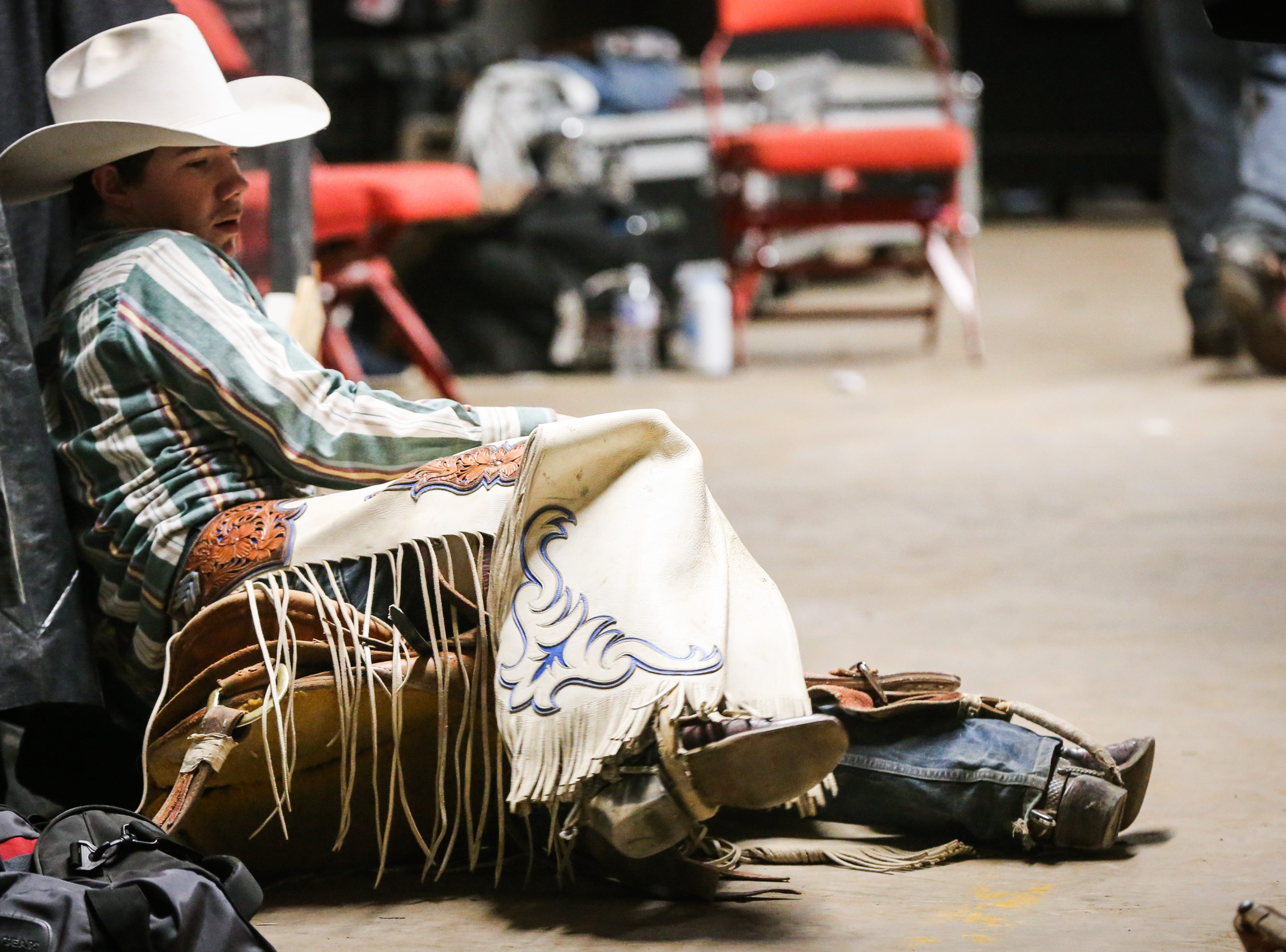 Sage Newman gets ready to ride a bronc during the San Angelo Stock Show & Rodeo matinee show Saturday, Feb. 9, 2019, at Foster Communications Coliseum.