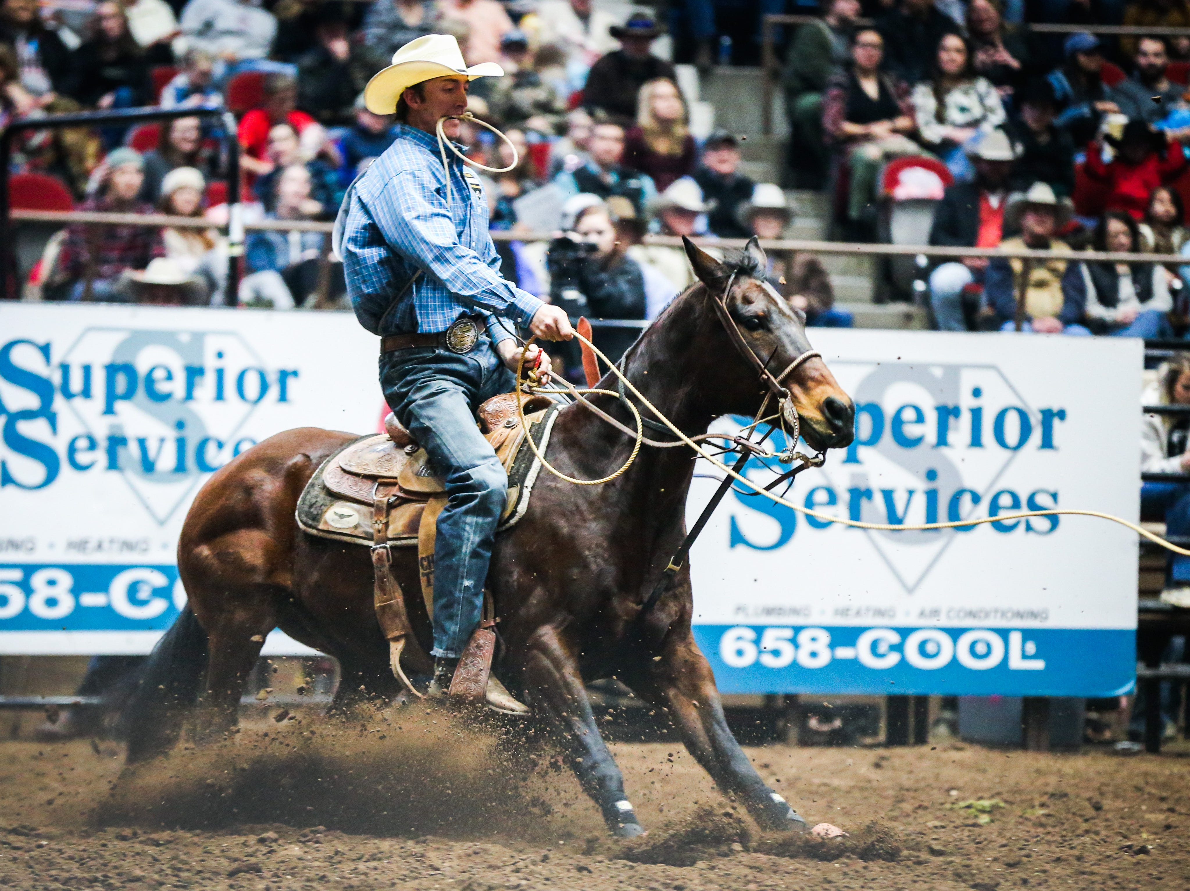 Taylor Santos rides out to tie down a calf during the San Angelo Stock Show & Rodeo matinee show Saturday, Feb. 9, 2019, at Foster Communications Coliseum.