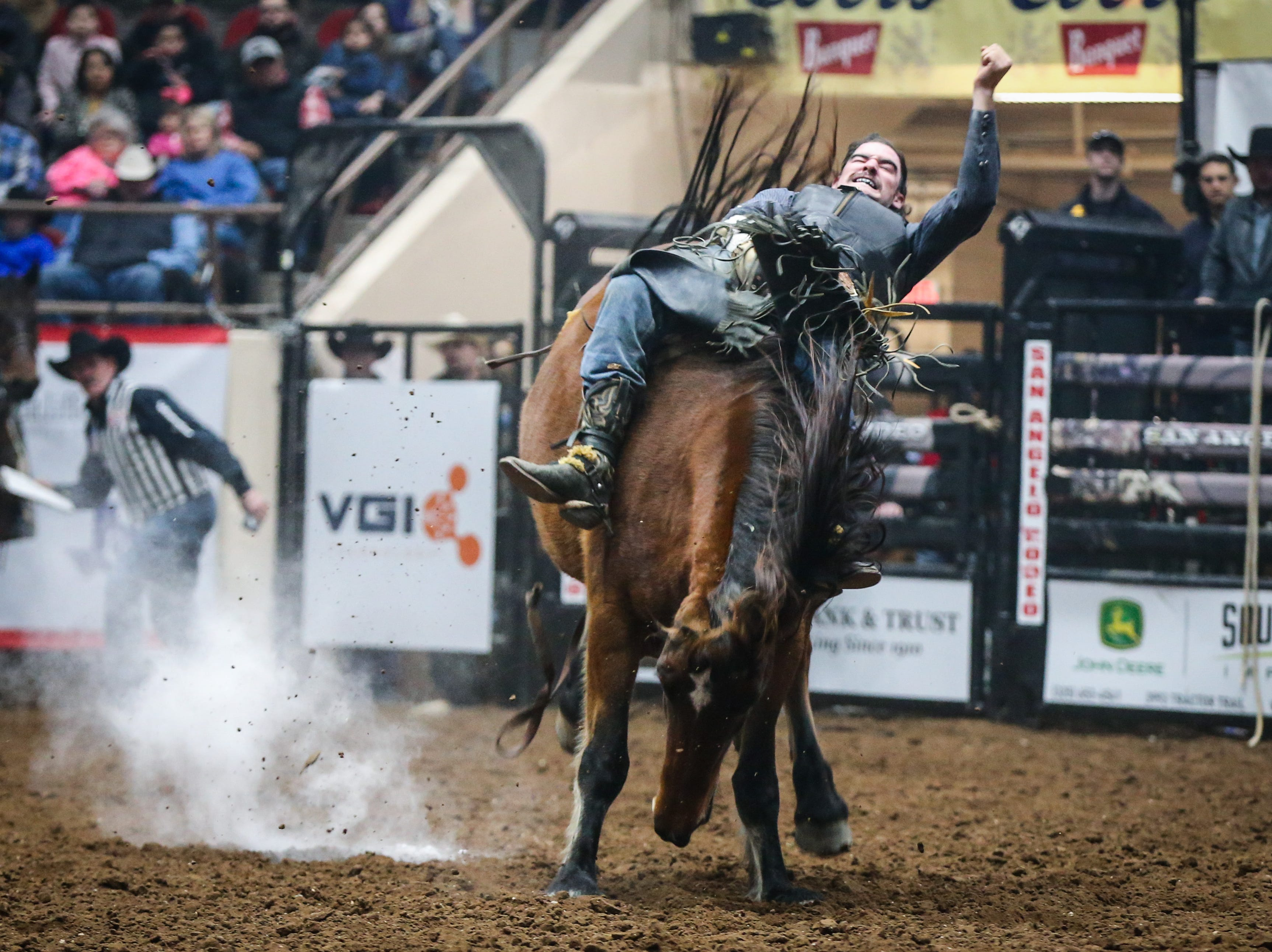 Hunter Carter rides bareback on Night Star during the San Angelo Stock Show & Rodeo matinee show Saturday, Feb. 9, 2019, at Foster Communications Coliseum.