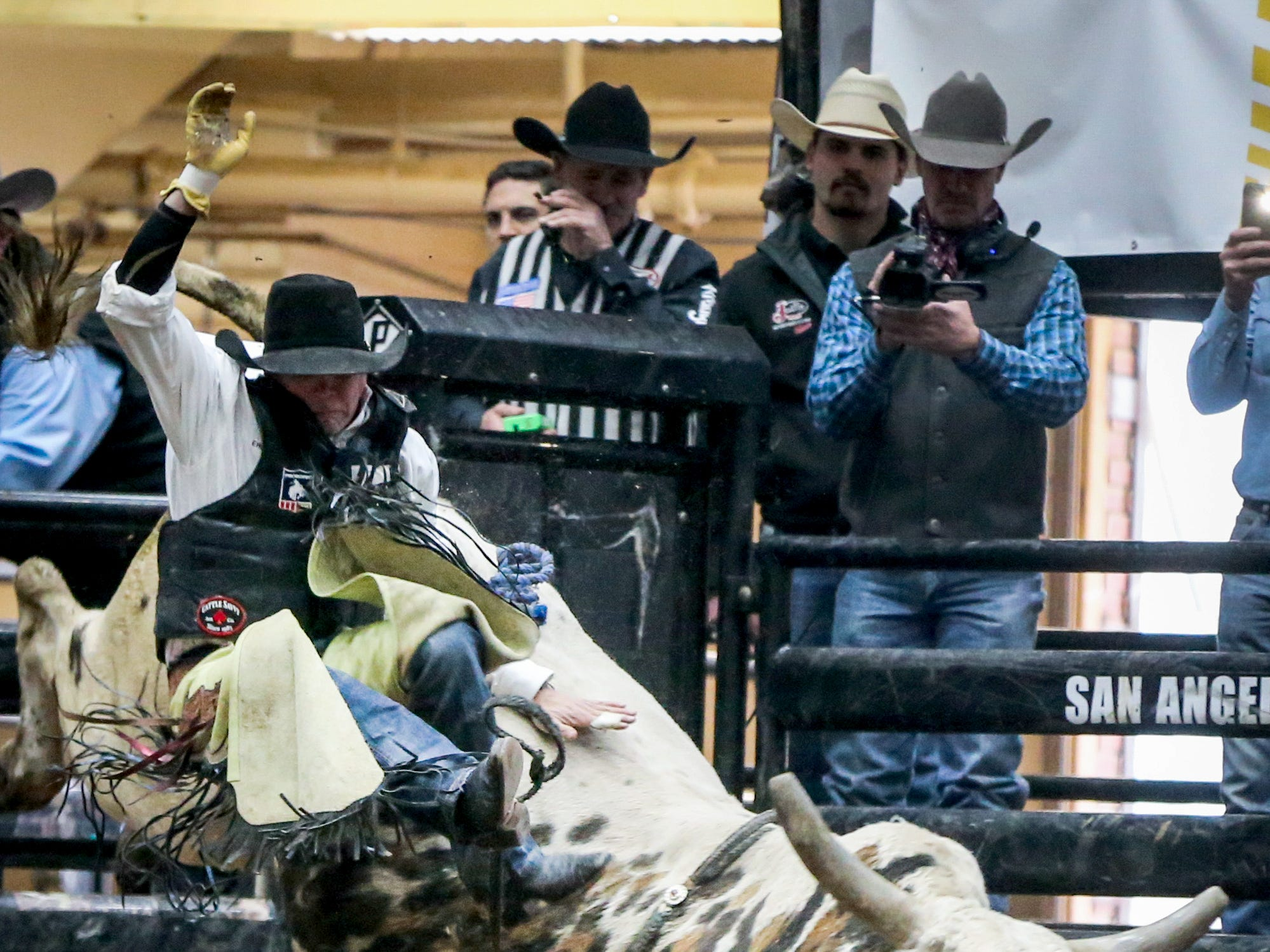 Erick Stevens rides a bull during the San Angelo Stock Show & Rodeo matinee show Saturday, Feb. 9, 2019, at Foster Communications Coliseum.