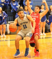 Lake View's David Tanguma dribbles against Sweetwater during a District 5-4A basketball game at Ben Norton Gym on Friday, Feb. 8, 2019.