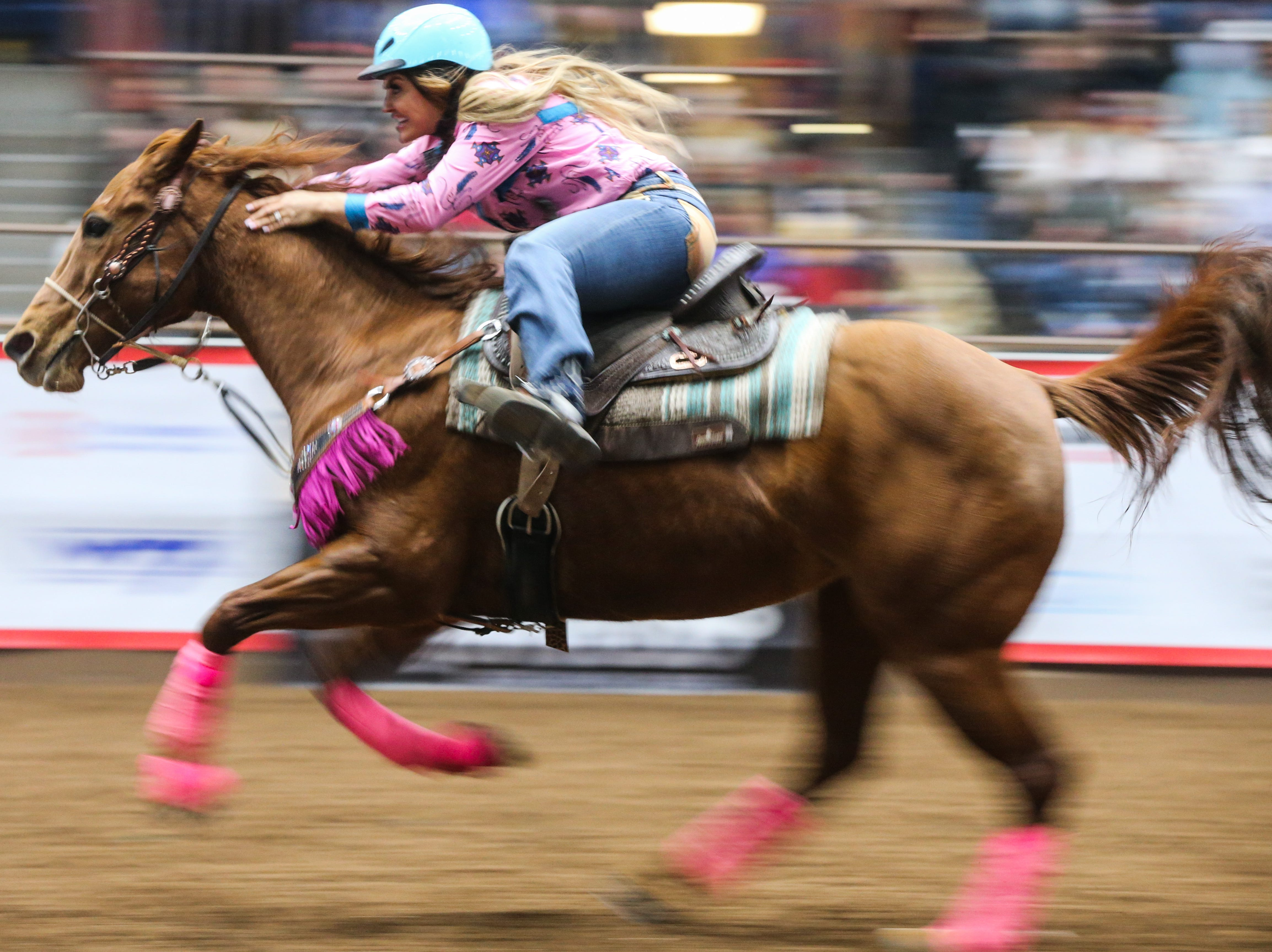 Fallon Taylor races the barrels during the 5th performance of the San Angelo Stock Show & Rodeo Friday, Feb. 8, 2019, at Foster Communications Coliseum.