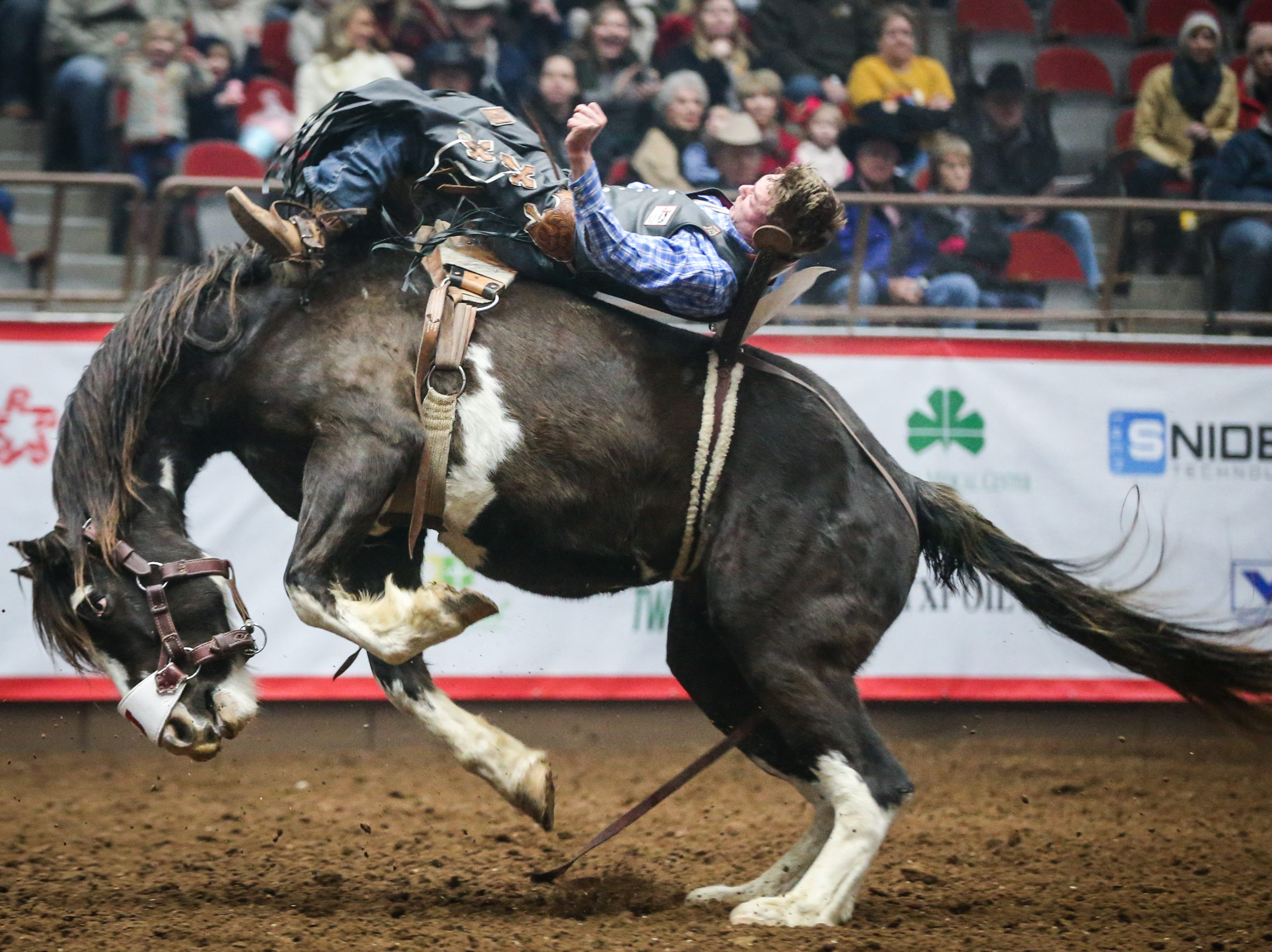 Mark Kreder rides bareback on Sweetwater during the San Angelo Stock Show & Rodeo matinee show Saturday, Feb. 9, 2019, at Foster Communications Coliseum.