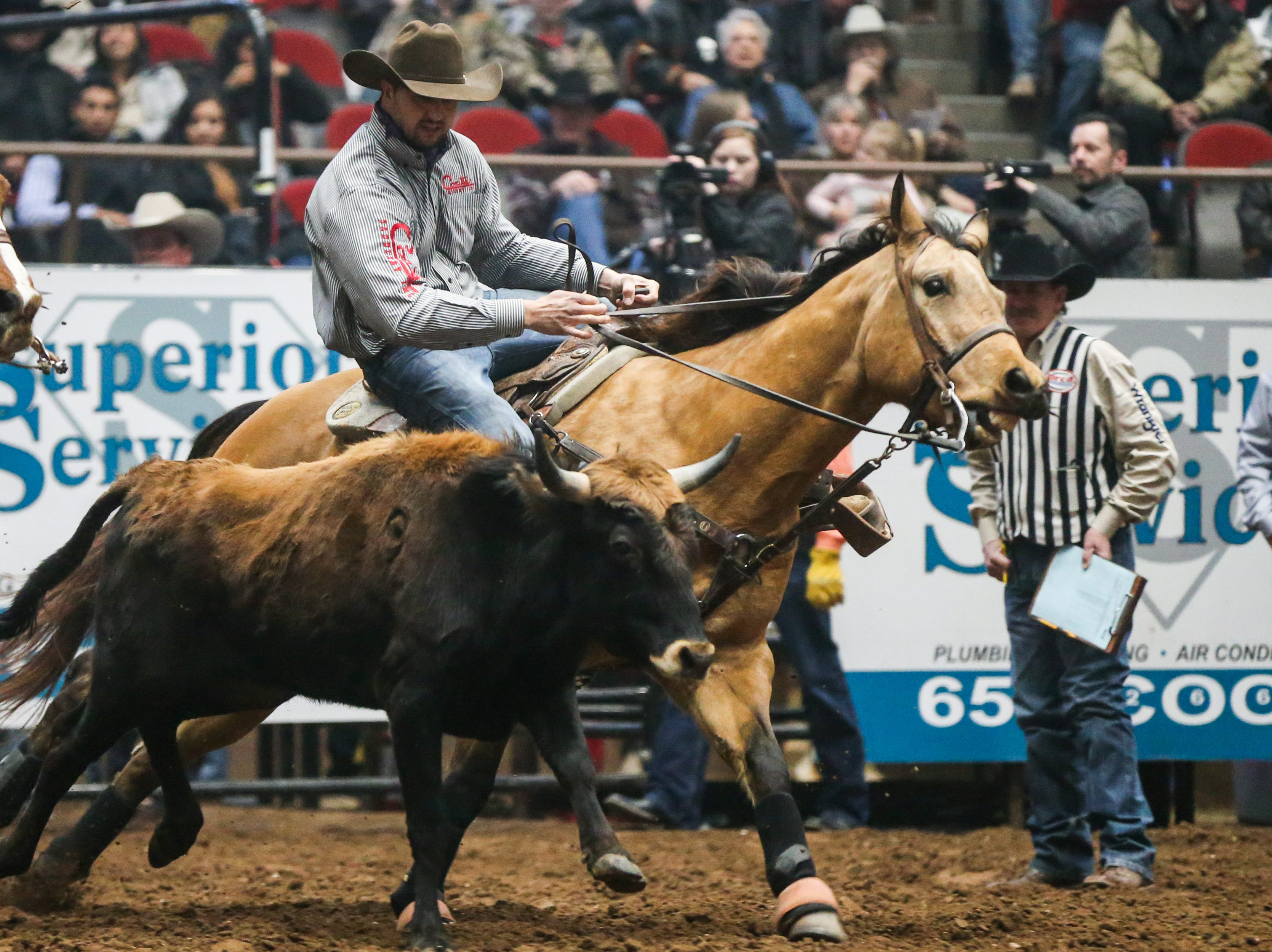 Derek Stewart rides out to wrestle a steer during the 5th performance of the San Angelo Stock Show & Rodeo Friday, Feb. 8, 2019, at Foster Communications Coliseum.
