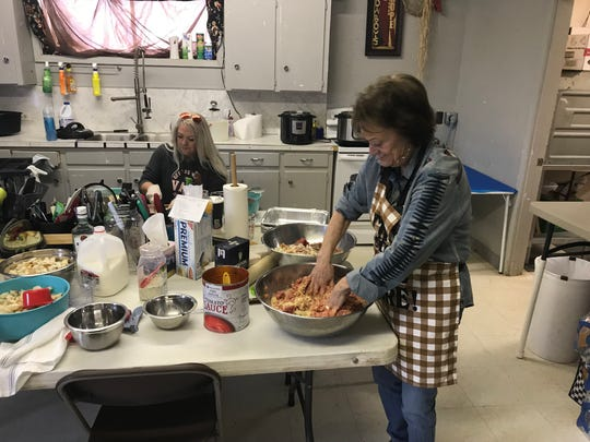 From left: Courtney Carr Reeves and Joyce Baker prepare homemade meatloaf to serve competitors at the San Angelo Rodeo on Friday, Feb. 8, 2019.