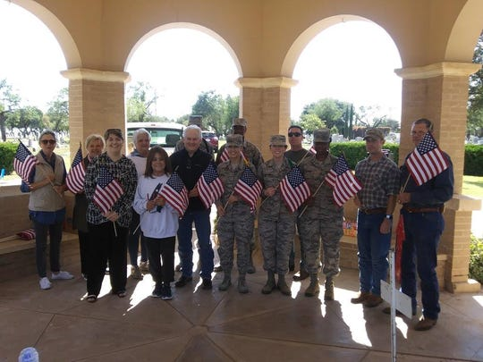 For a second year, Tommy Wood, local Financial Representative with Woodmen Life, donated 432 flags to the Friends of Fairmount Cemetery in San Angelo. They  will replace worn and tattered flags used to mark veterans' graves for during the Veterans Day ceremony.  Pictured are several board members, Wood, along with a number of Military Personnel from Goodfellow, AFB and Charles Westbrook, event emcee.