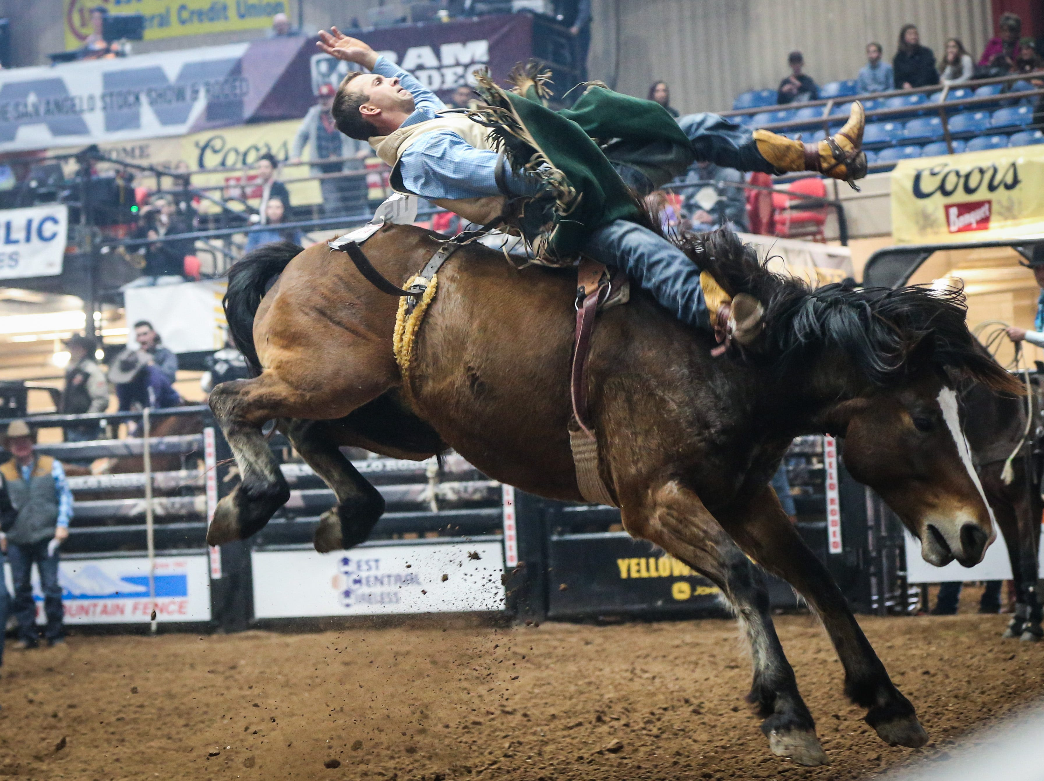 Cody Cabeen rides bareback on Shady Nights during the San Angelo Stock Show & Rodeo matinee show Saturday, Feb. 9, 2019, at Foster Communications Coliseum.