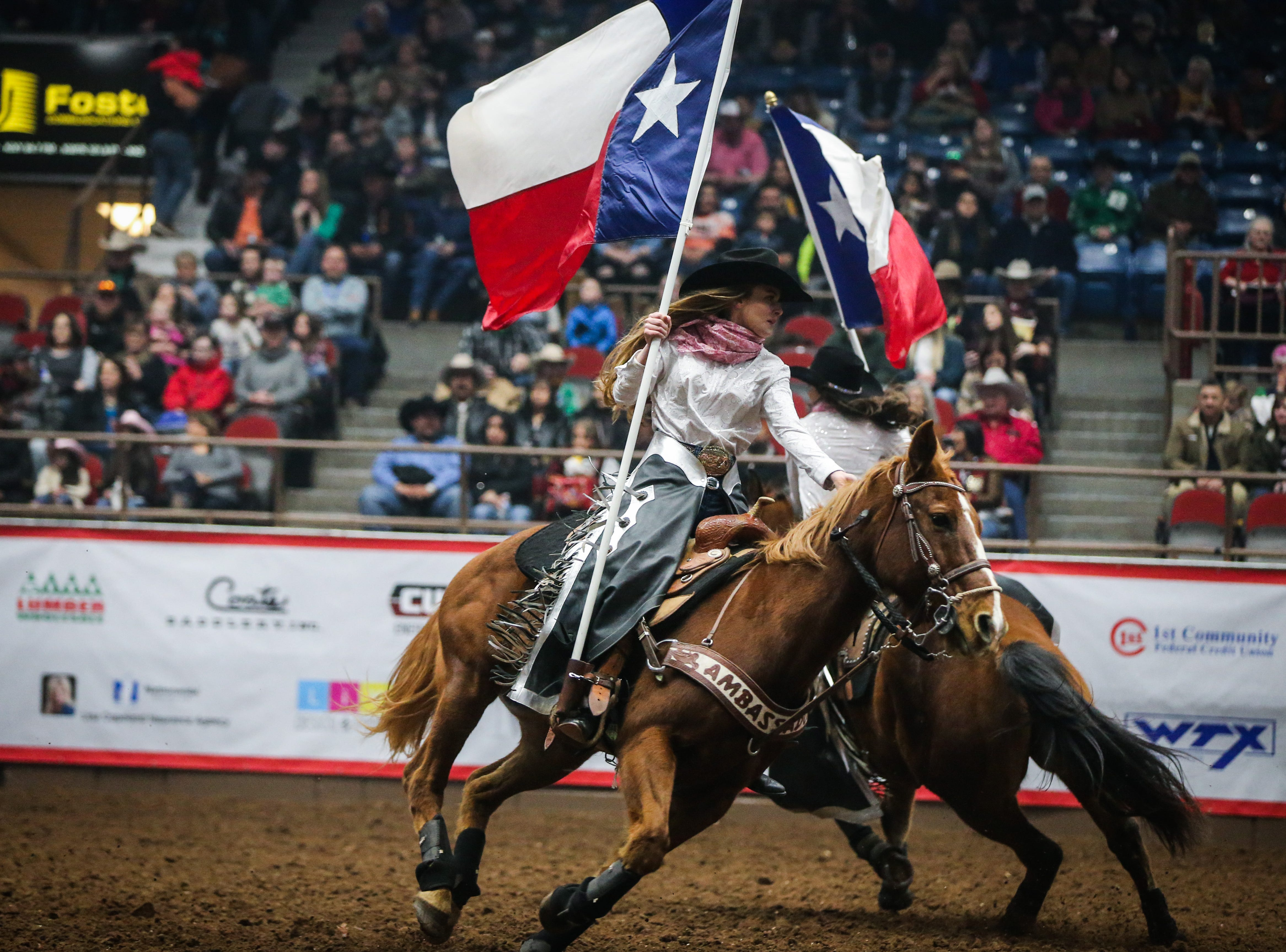 The San Angelo Ambassadors ride in the arena during the San Angelo Stock Show & Rodeo matinee show Saturday, Feb. 9, 2019, at Foster Communications Coliseum.