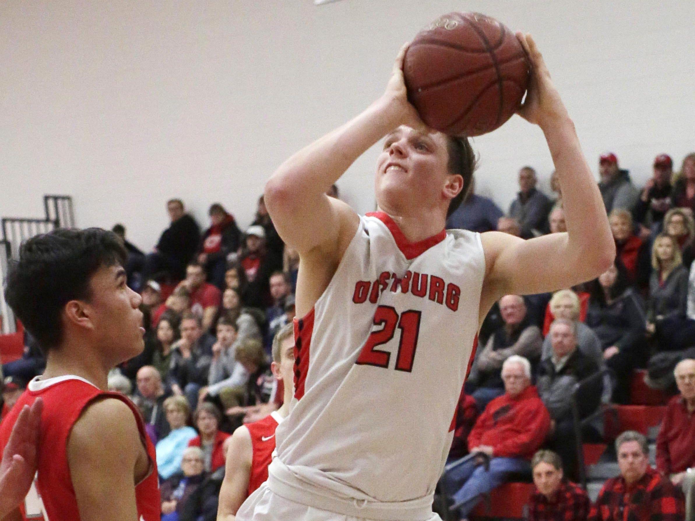 Oostburg's Ashtin Smies (21) looks to the basket against Manitowoc Lutheran, Friday, February 8, 2019, in Oostburg, Wis. Gary C. Klein/USA TODAY NETWORK-Wisconsin