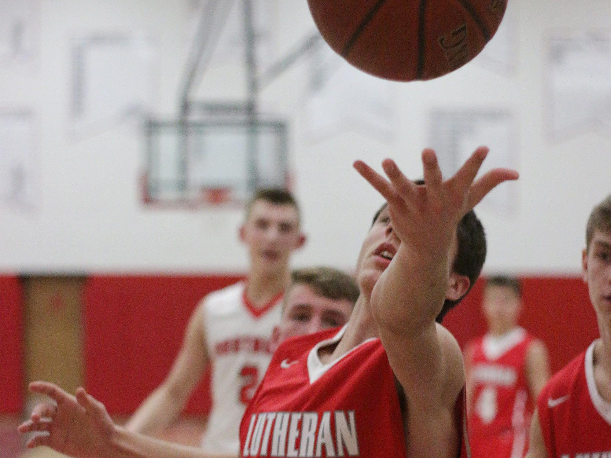 Manitowoc Lutheran's Simeon Poehlman (24) reaches for a loose ball during action with Oostburg, Friday, February 8, 2019, in Oostburg, Wis. Gary C. Klein/USA TODAY NETWORK-Wisconsin