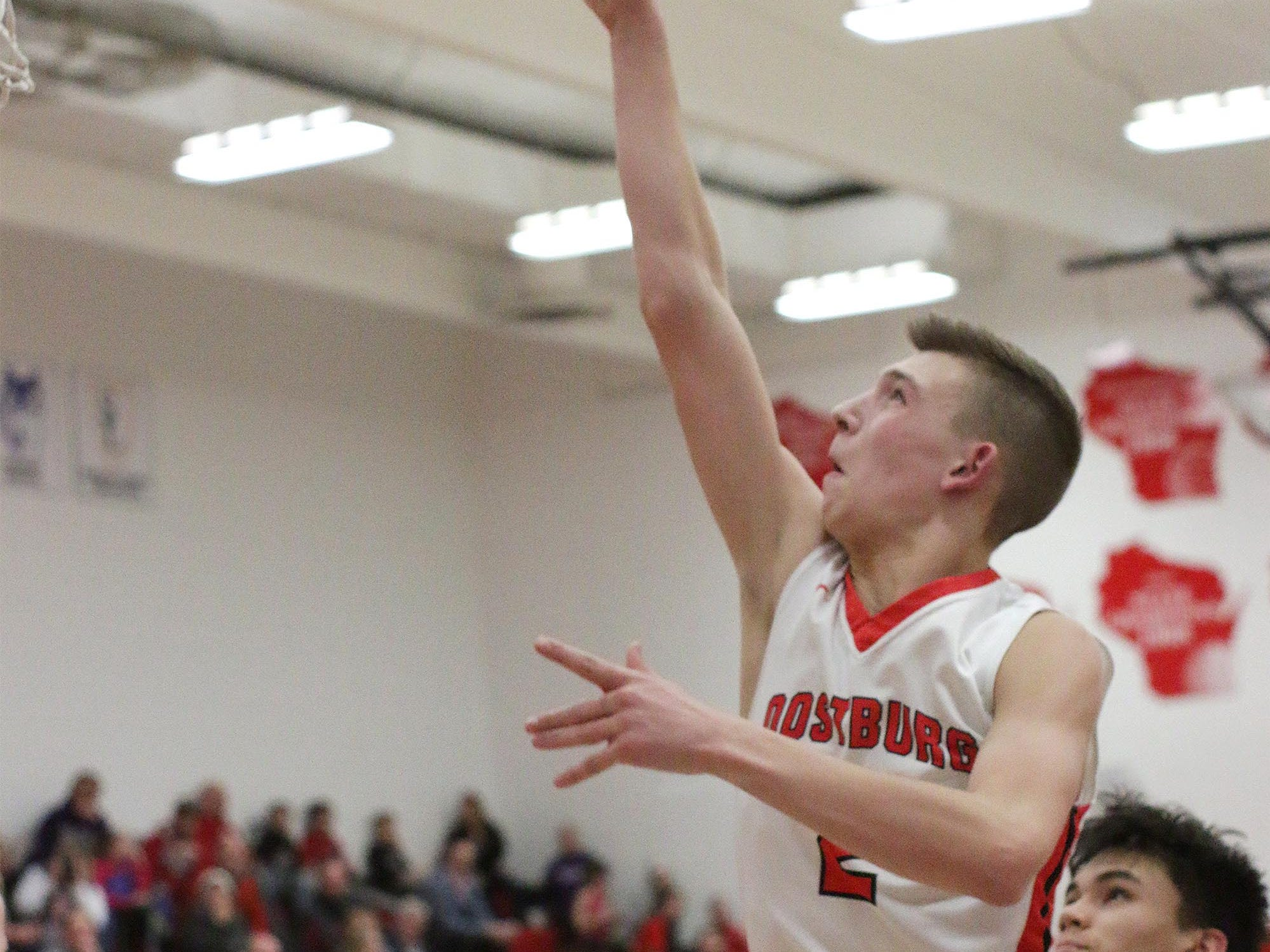 Oostburg's Cam Jaeger (2) aims a shot against Manitowoc Lutheran, Friday, February 8, 2109, in Oostburg, Wis. Gary C. Klein/USA TODAY NETWORK-Wisconsin