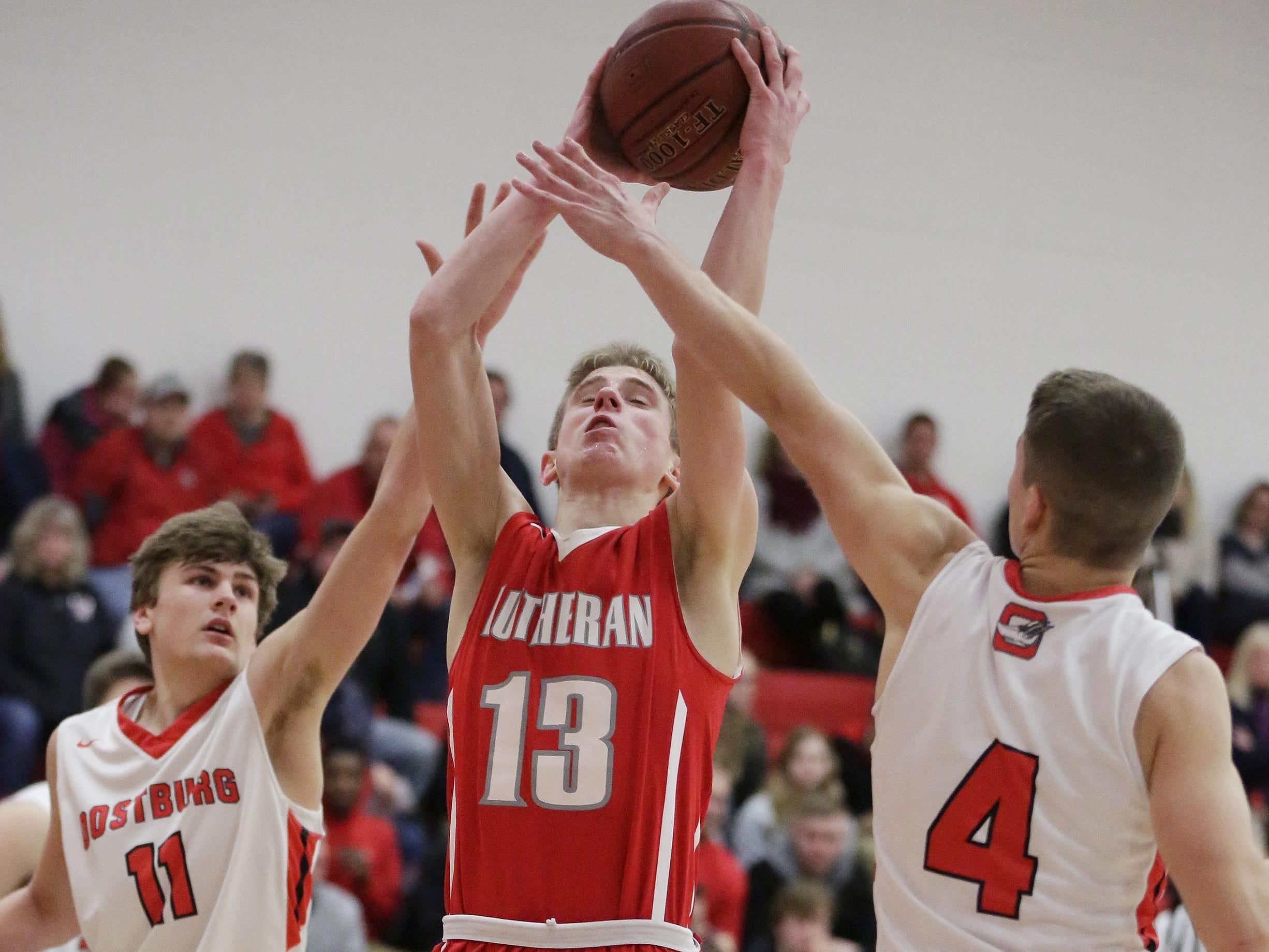 Manitowoc Lutheran's Evan Lischka (13) aims a shot against Oostburg, Friday, February 8, 2019, in Oostburg, Wis. Gary C. Klein/USA TODAY NETWORK-Wisconsin