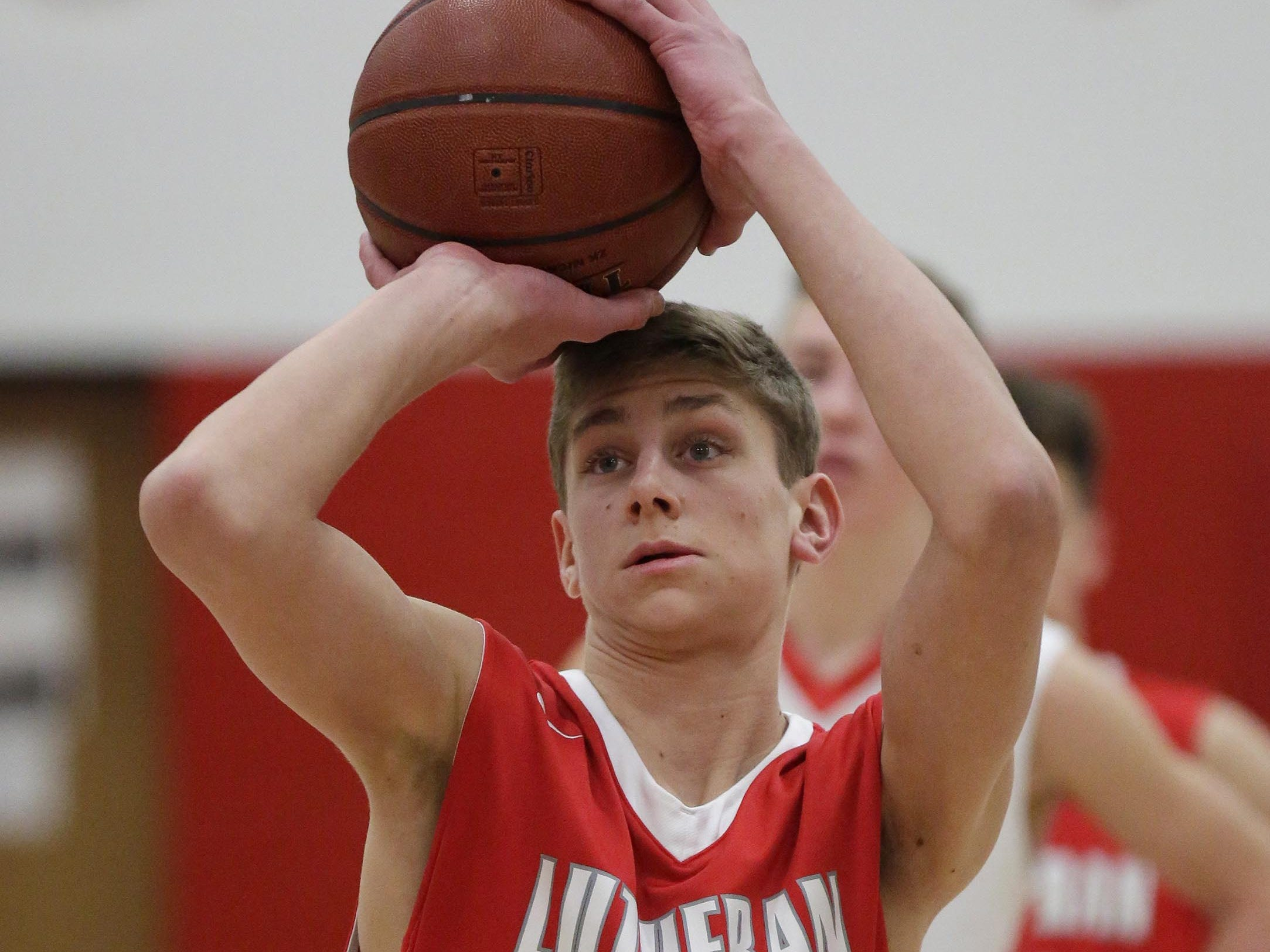 Manitowoc Lutheran's Nathaniel Luebke (44) aims a free throw against Oostburg, Friday, February 8, 2019, in Oostburg, Wis. Gary C. Klein/USA TODAY NETWORK-Wisconsin