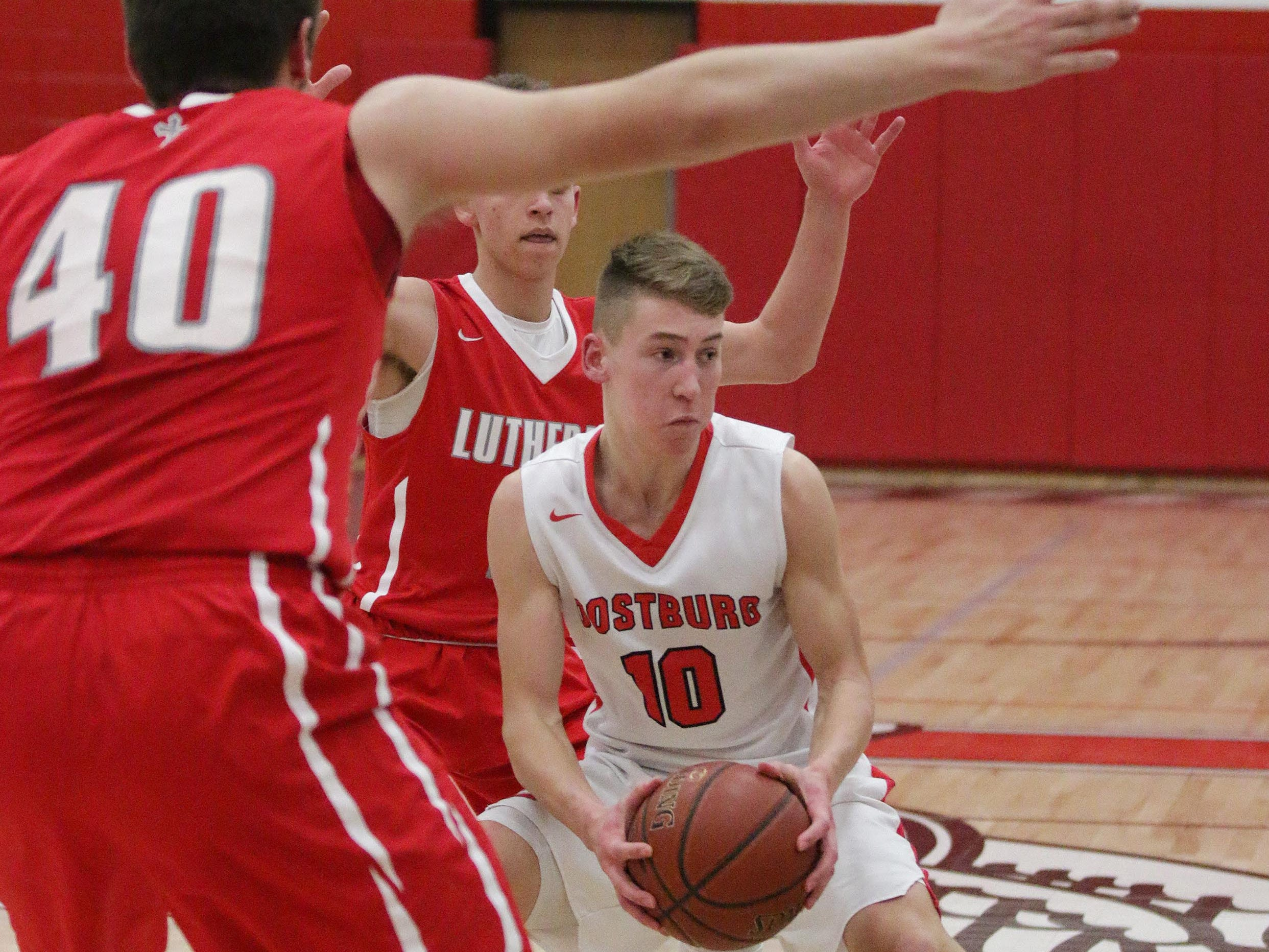 Oostburg's Braden Dirkse (10) looks to pass the ball while being surrounded by Manitowoc Lutheran players, Friday, February 8, 2019, in Oostburg, Wis. Gary C. Klein/USA TODAY NETWORK-Wisconsin