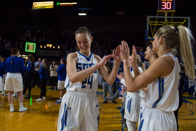 South Dakota State's Tagyn Larson (24) gives high fives to her teammates before the game against North Dakota in Brookings, S.D., Saturday, Feb. 9, 2019.