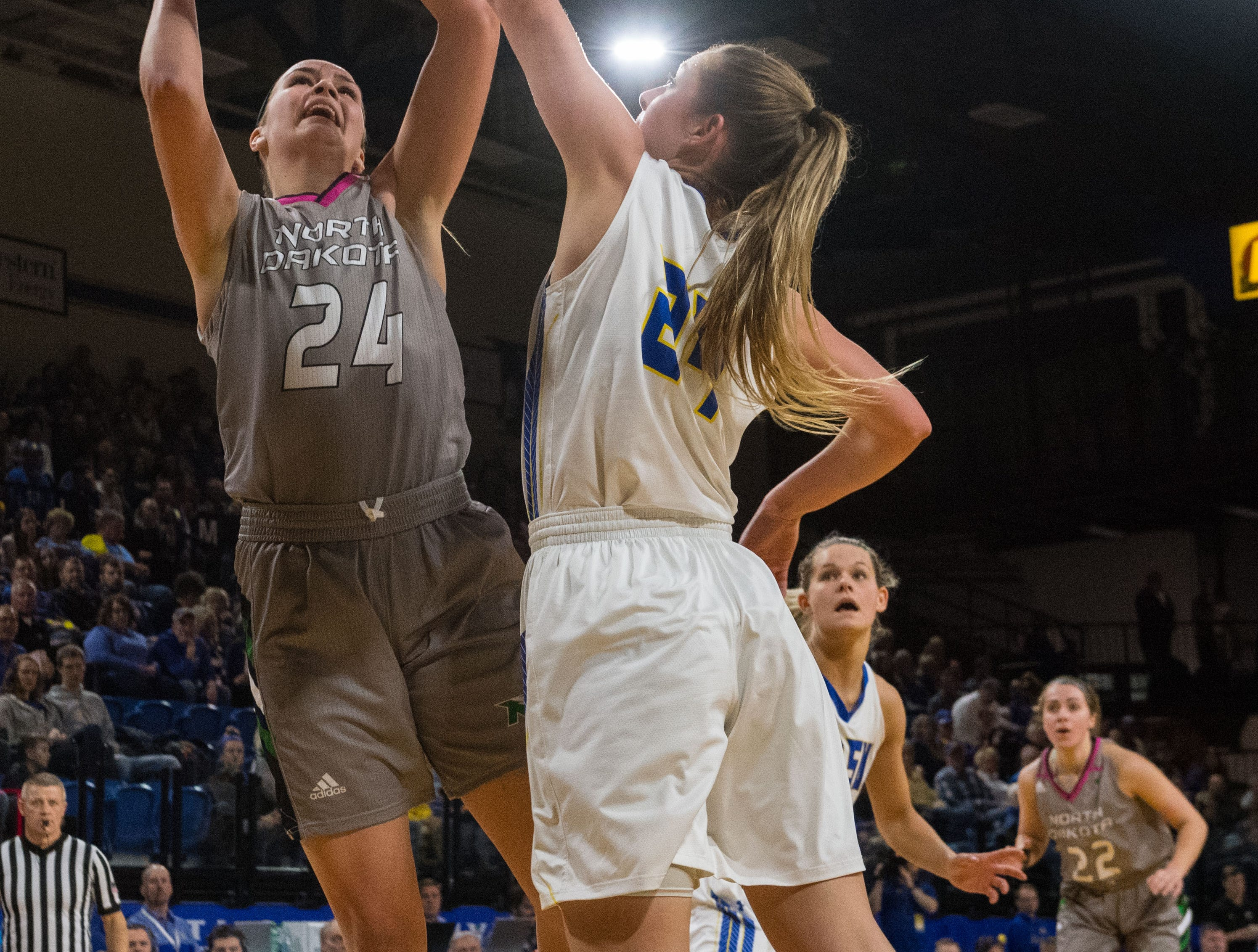 South Dakota State's Tagyn Larson (24) tries to block North Dakota's Julia Fleecs (24) from making a shot during a game in Brookings, S.D., Saturday, Feb. 9, 2019.