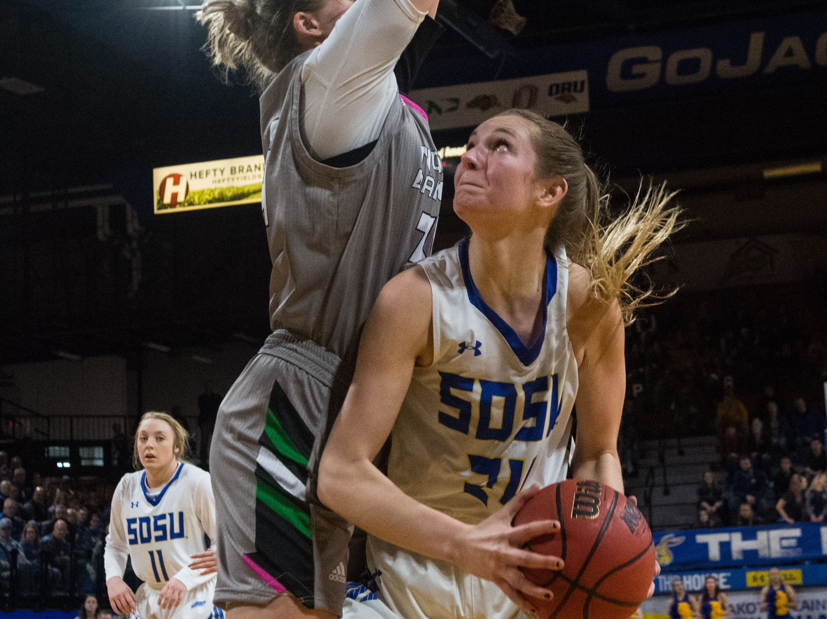 South Dakota State's Tagyn Larson (24) prepares to shoot the ball during a game against North Dakota in Brookings, S.D., Saturday, Feb. 9, 2019.