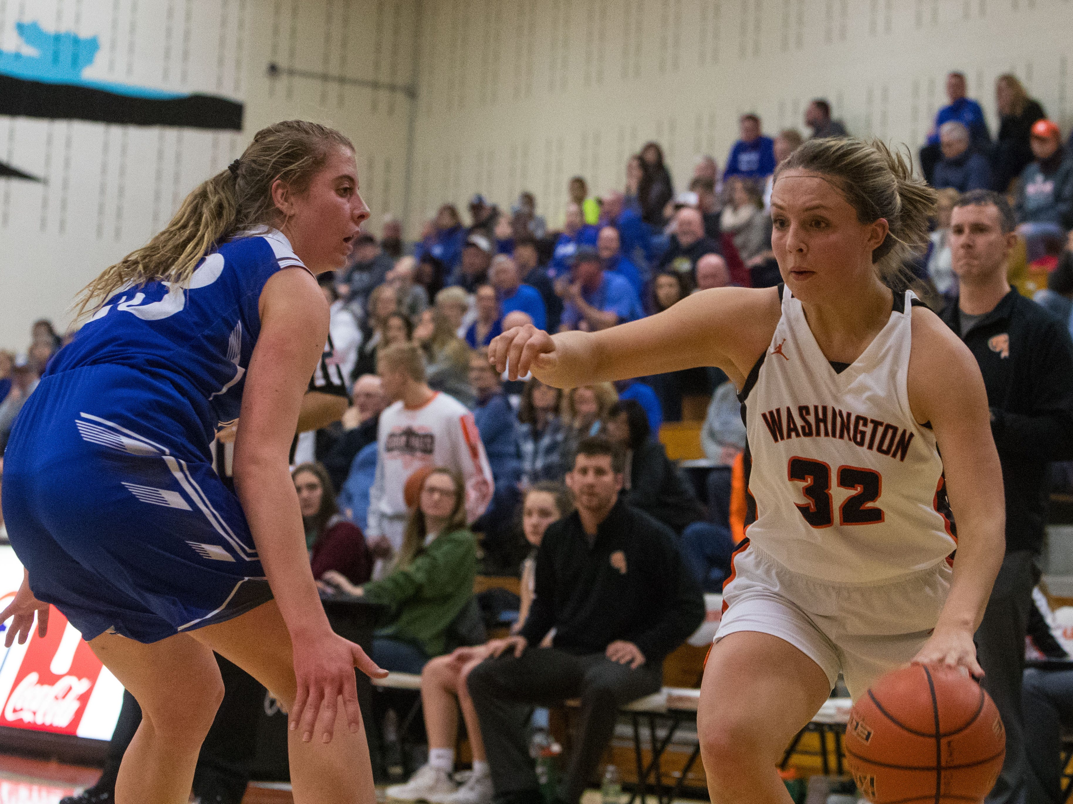 Washington's Peyton Rymerson (32) dribbles the ball past Rapid City Stevens player during a game in Sioux Falls, S.D., Friday, Feb. 8, 2019.