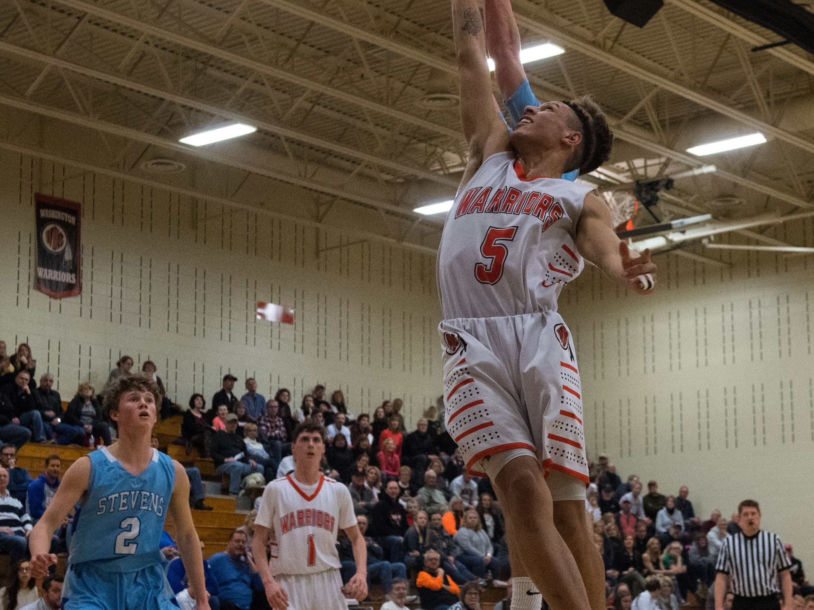 Washington's Eli Williams (5) goes up for the ball during a game against Rapid City Stevens' in Sioux Falls, S.D., Thursday, Feb. 7, 2019.