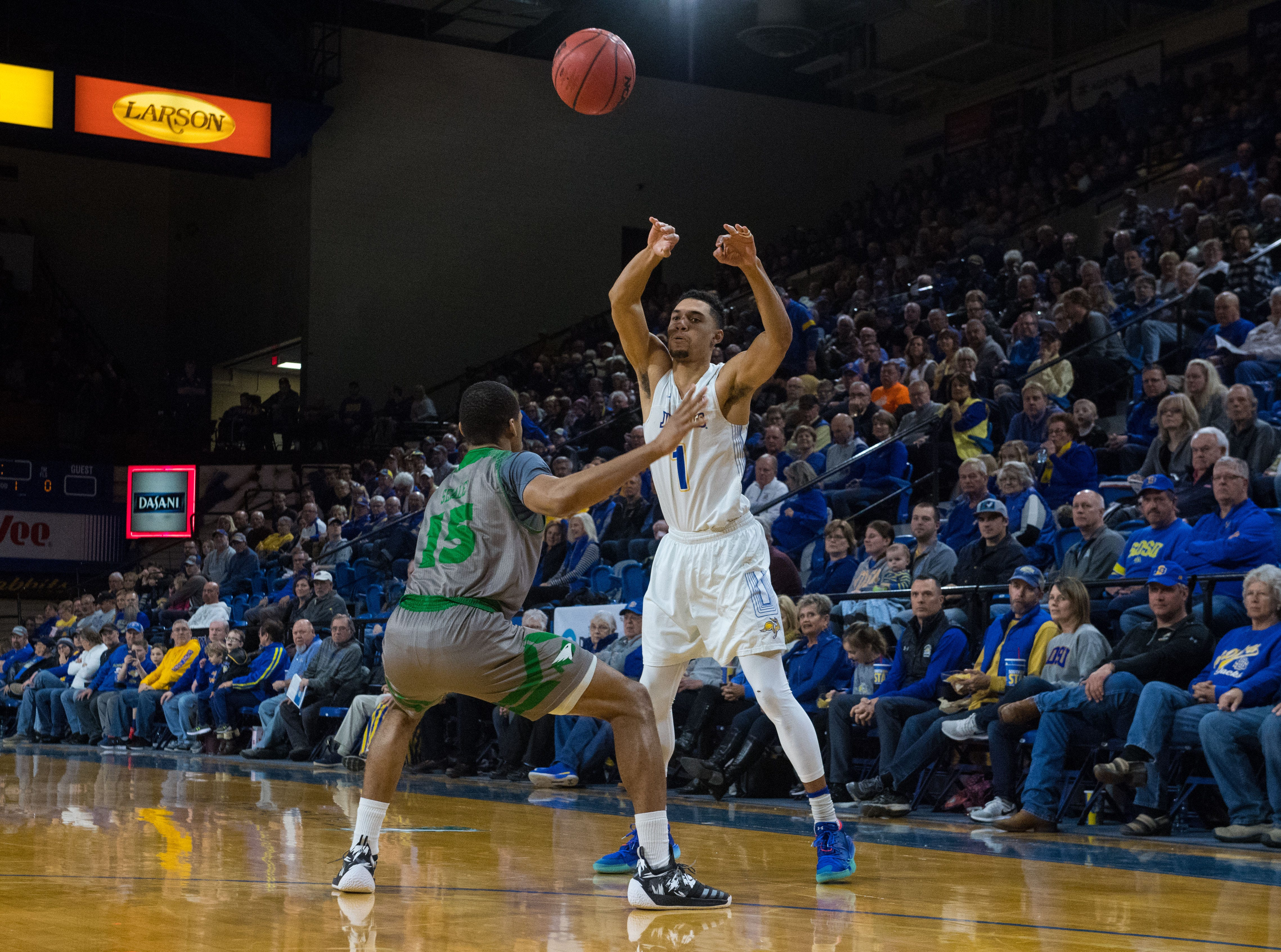 South Dakota State's Skyler Flatten (1) throws the ball over North Dakota's Cortez Seales (15) during a game in Brookings, S.D., Saturday, Feb. 9, 2019.