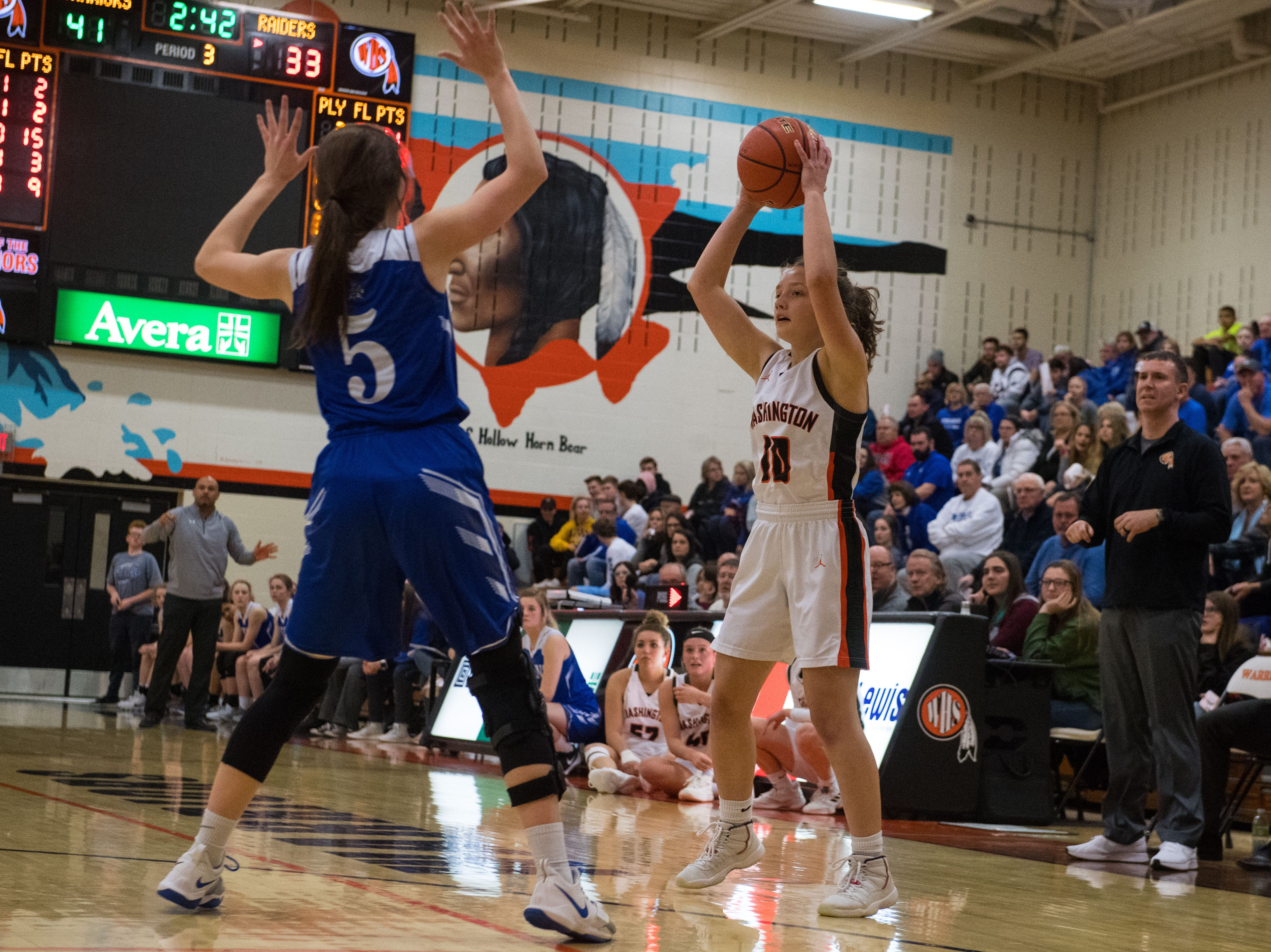 Washington's Eden Hullinger (10) looks to pass the ball during a game against Rapid City Stevens in Sioux Falls, S.D., Friday, Feb. 8, 2019.