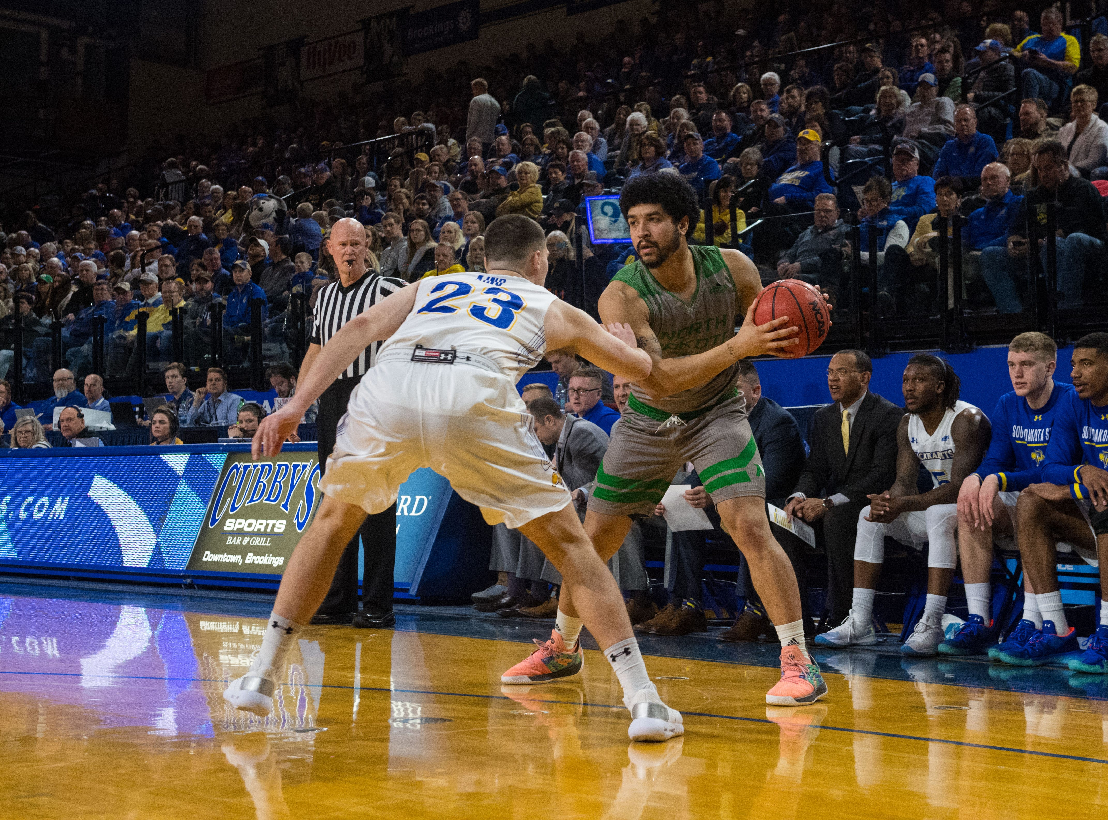 North Dakota's Marlon Stewart (1) looks to pass the ball during a game against South Dakota State in Brookings, S.D., Saturday, Feb. 9, 2019.