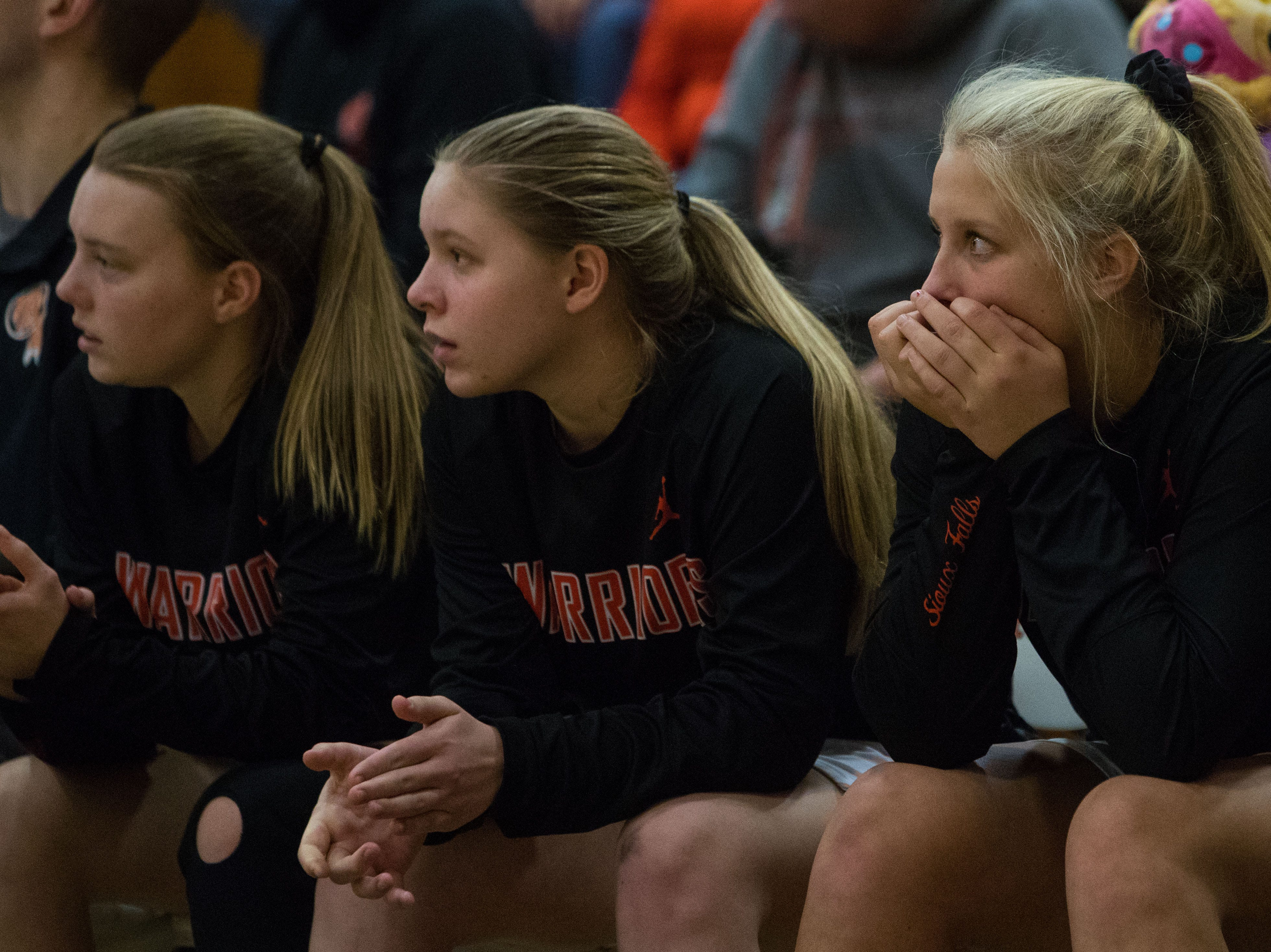 Washington players watch the Rapid City Stevens game in Sioux Falls, S.D., Friday, Feb. 8, 2019.