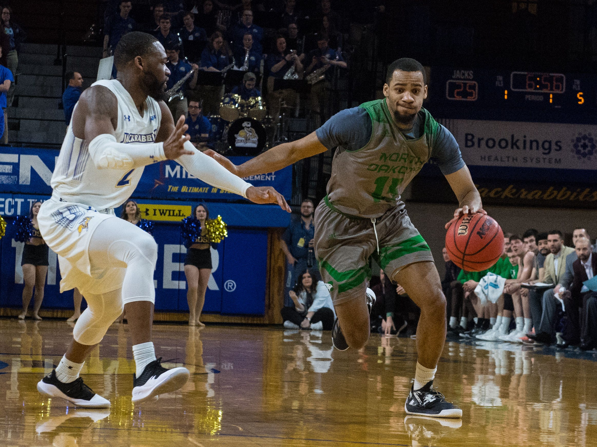 North Dakota's Cortez Seales (15) dribbles the ball past South Dakota State's Tevin King (2) during a game in Brookings, S.D., Saturday, Feb. 9, 2019.