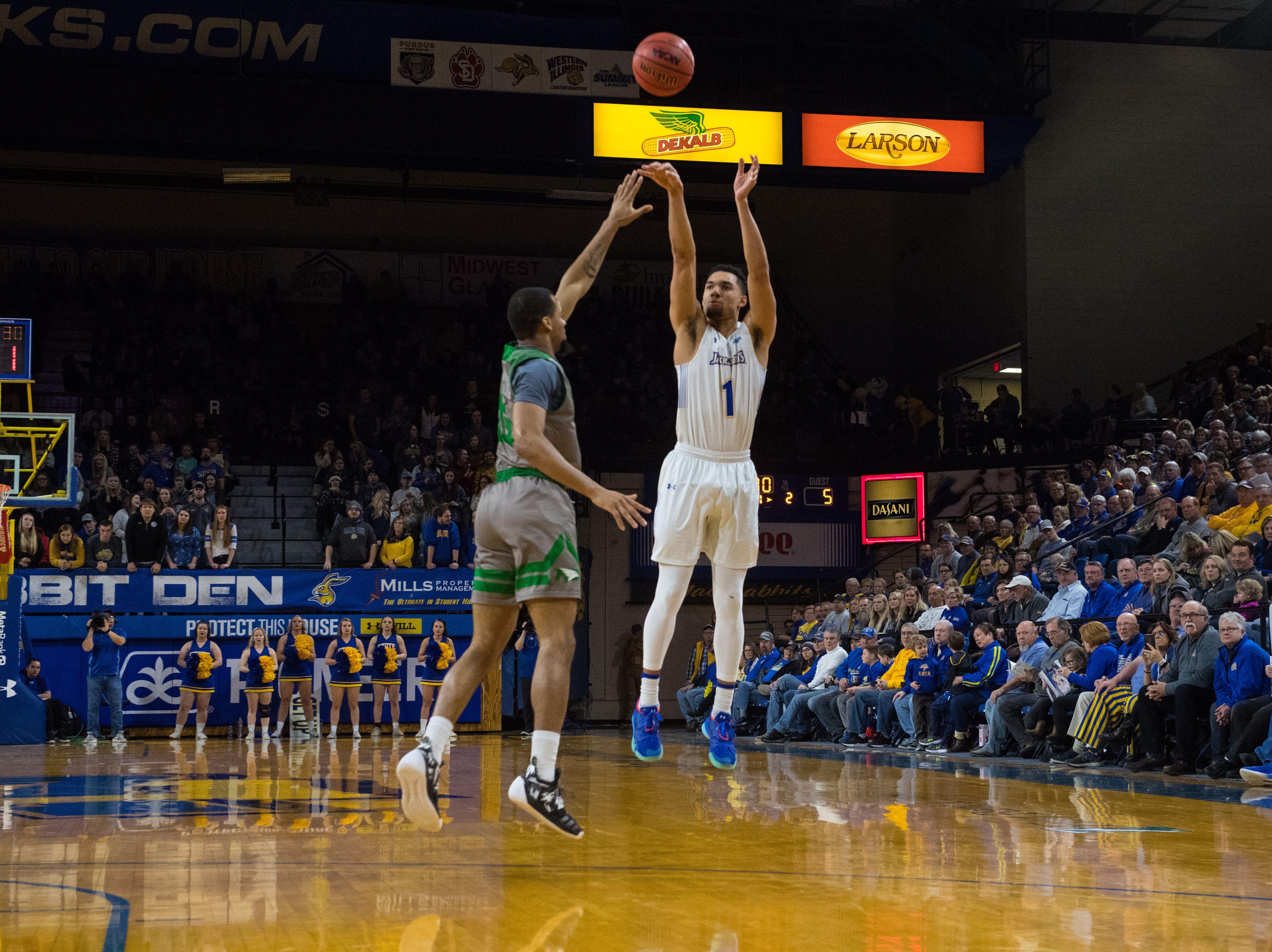 South Dakota State's Skyler Flatten (1) shoots the ball during a game against North Dakota in Brookings, S.D., Saturday, Feb. 9, 2019.