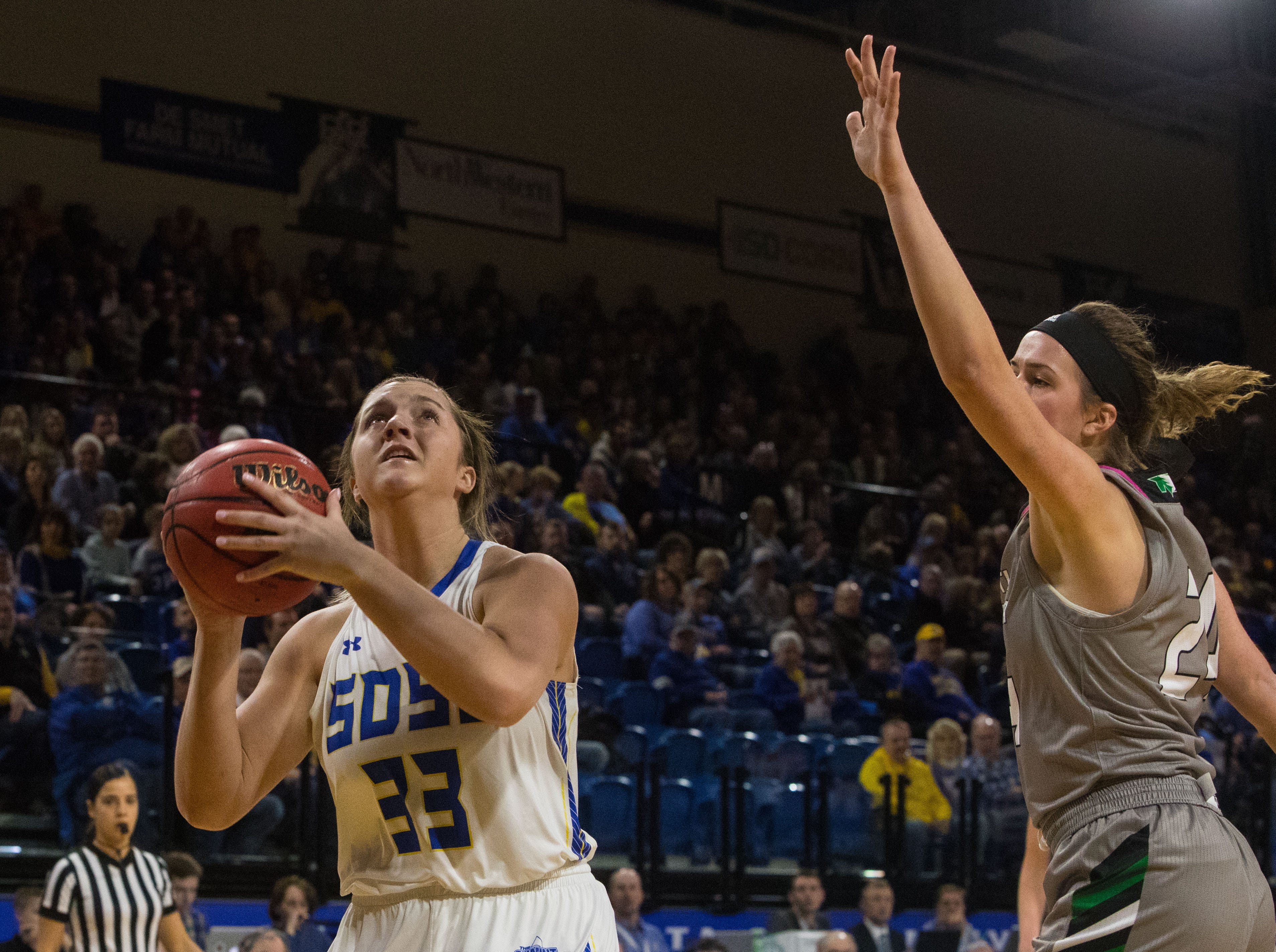 South Dakota State's Paiton Burckhard (33) goes up for a shot during a game against North Dakota in Brookings, S.D., Saturday, Feb. 9, 2019.