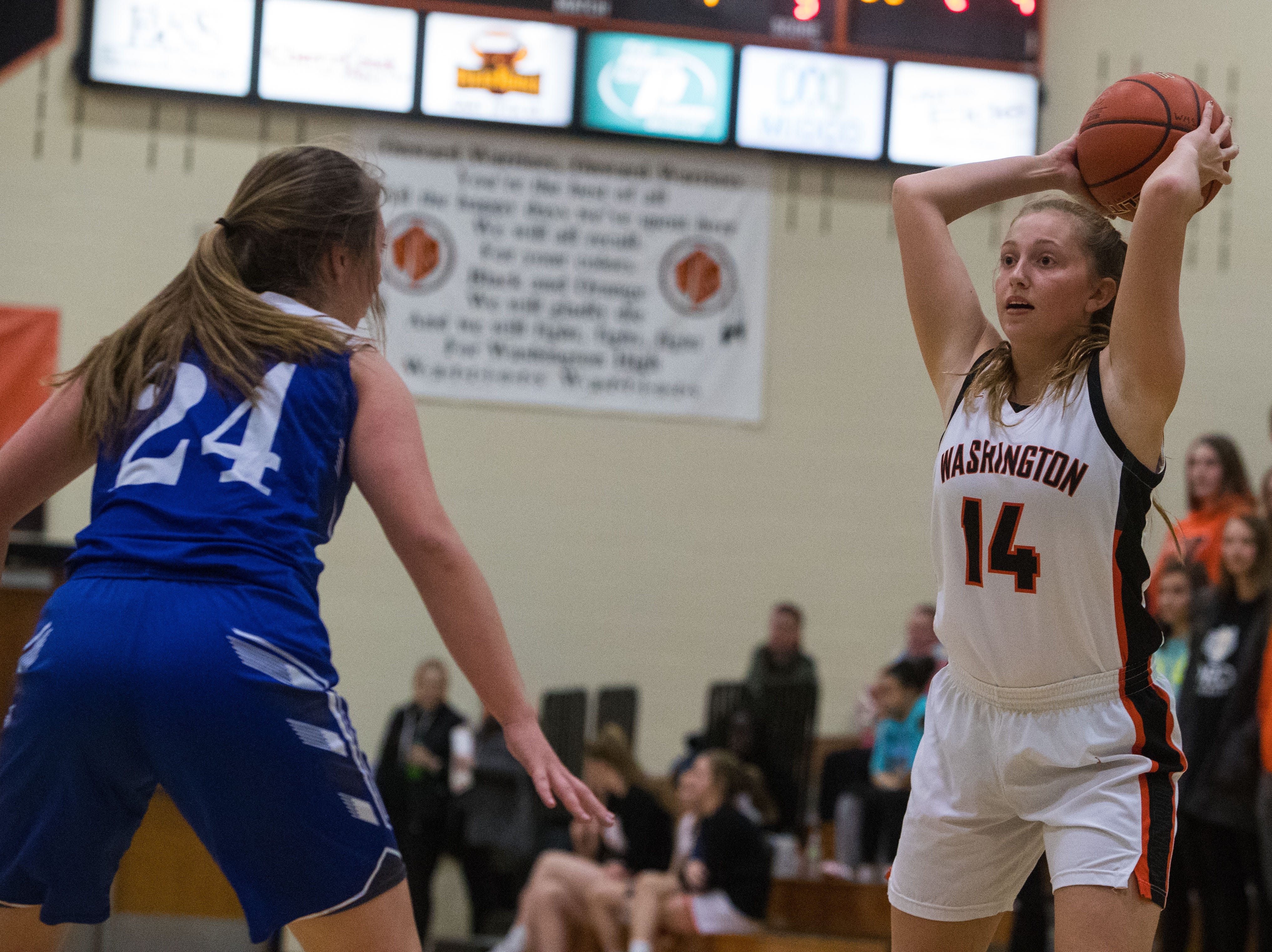 Washington's Rylyn Fink (14) looks to pass the ball during a game against Rapid City Stevens in Sioux Falls, S.D., Friday, Feb. 8, 2019.