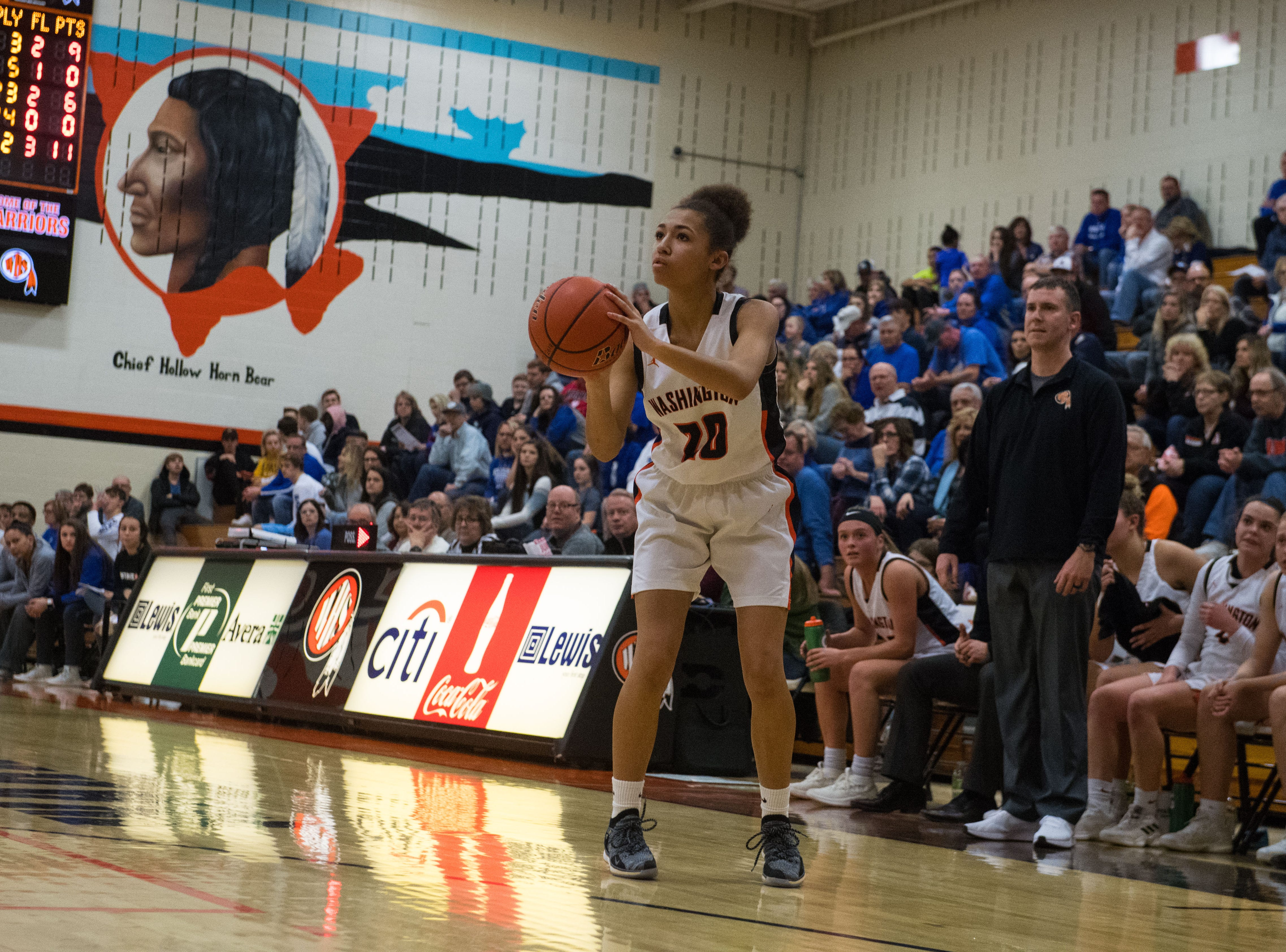 Washington's Brielle Biteler (20) shoots the ball during a game against Rapid City Stevens in Sioux Falls, S.D., Friday, Feb. 8, 2019.