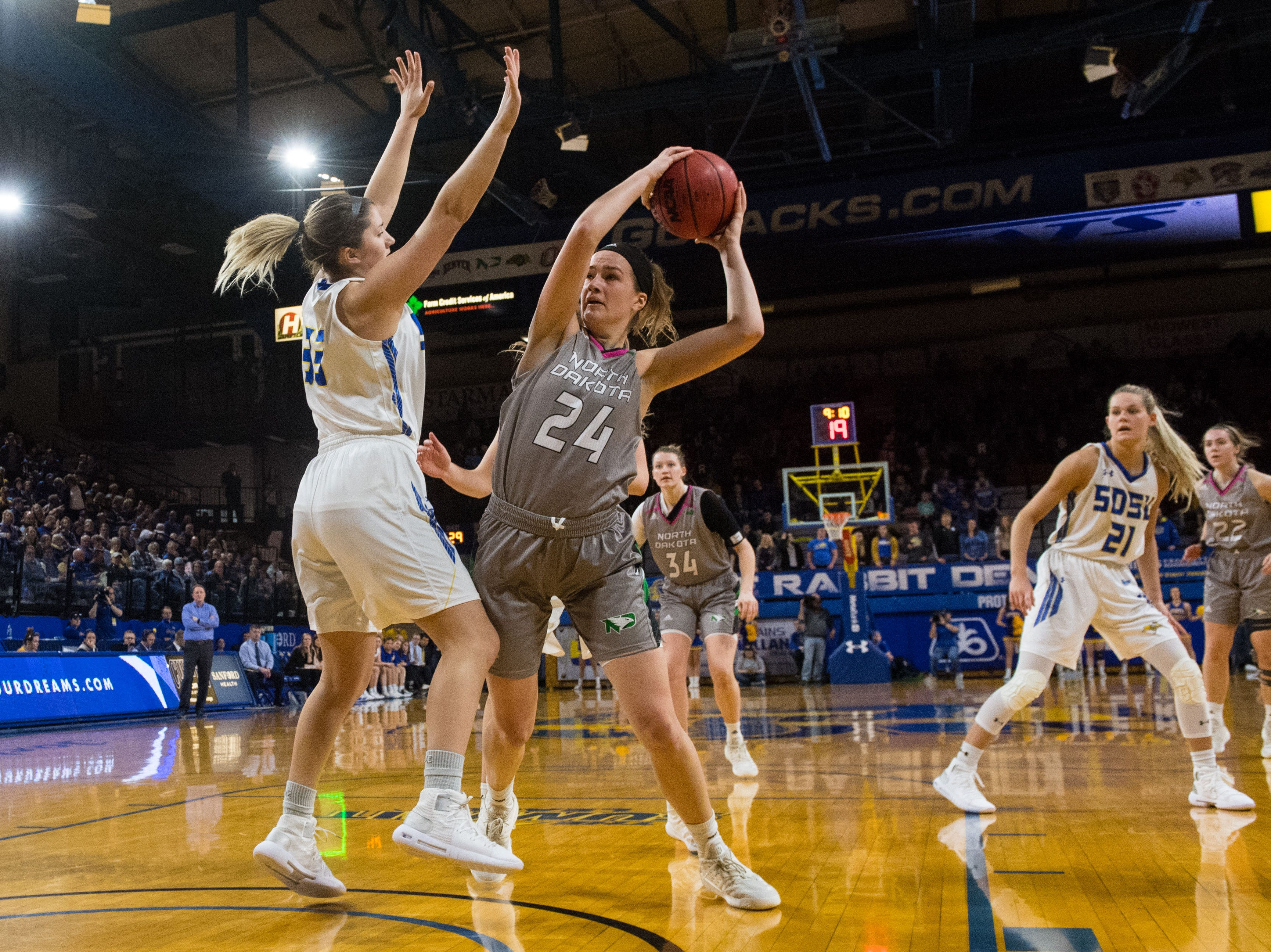 North Dakota's Julia Fleecs (24) looks to pass the ball during a game against South Dakota State in Brookings, S.D., Saturday, Feb. 9, 2019.