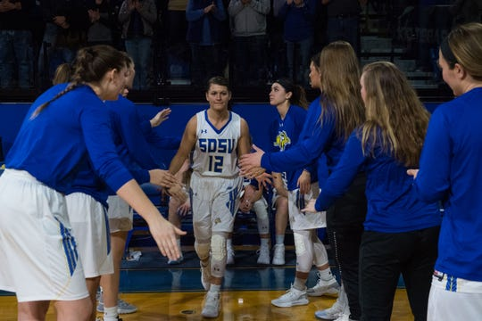South Dakota State's Macy Miller (12) gets introduced to the crowd before the game against North Dakota in Brookings, S.D., Saturday, Feb. 9, 2019.