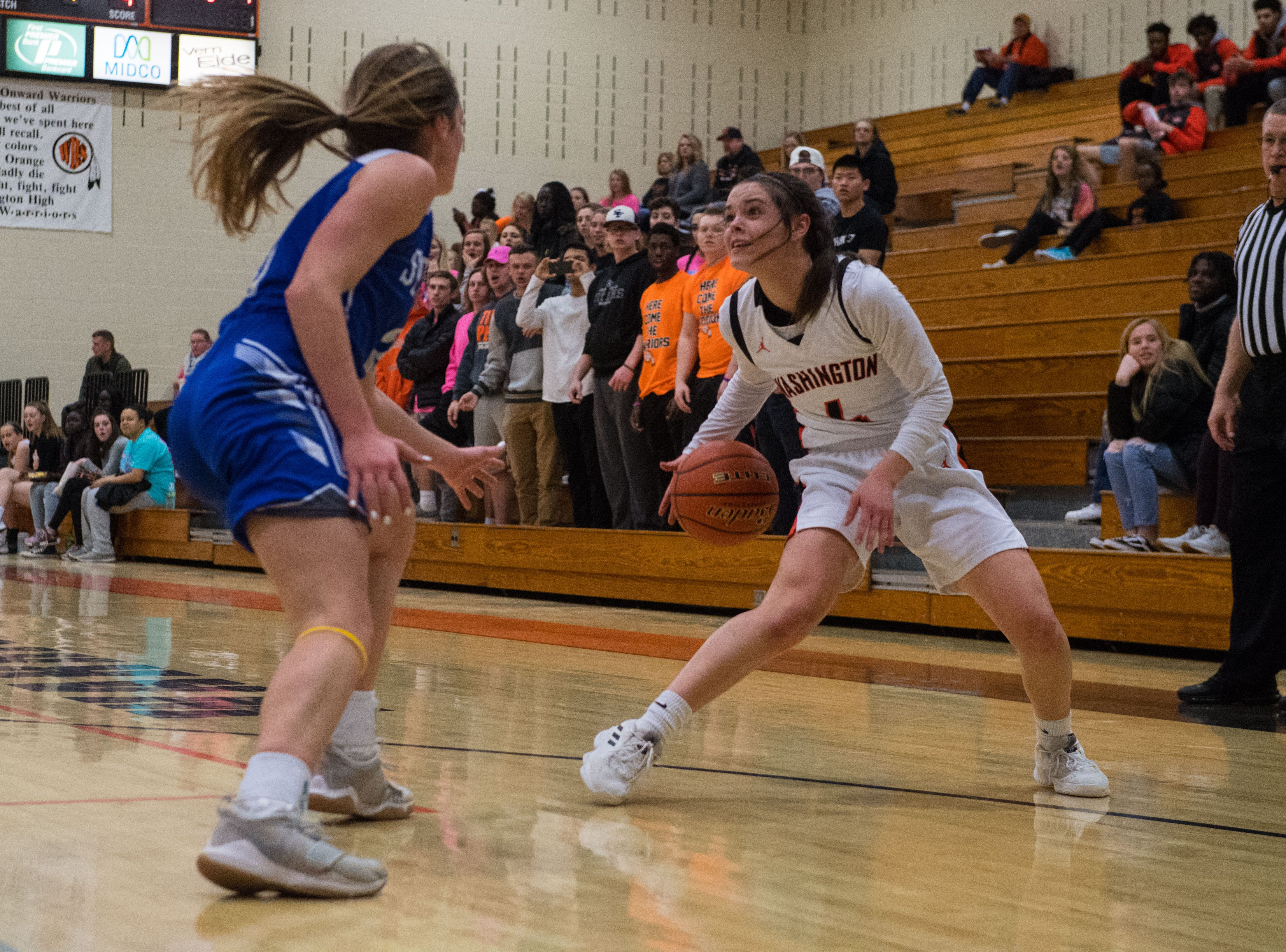 Washington's Brynn Heinert (4) dribbles the ball past Rapid City Stevens player during a game in Sioux Falls, S.D., Friday, Feb. 8, 2019.