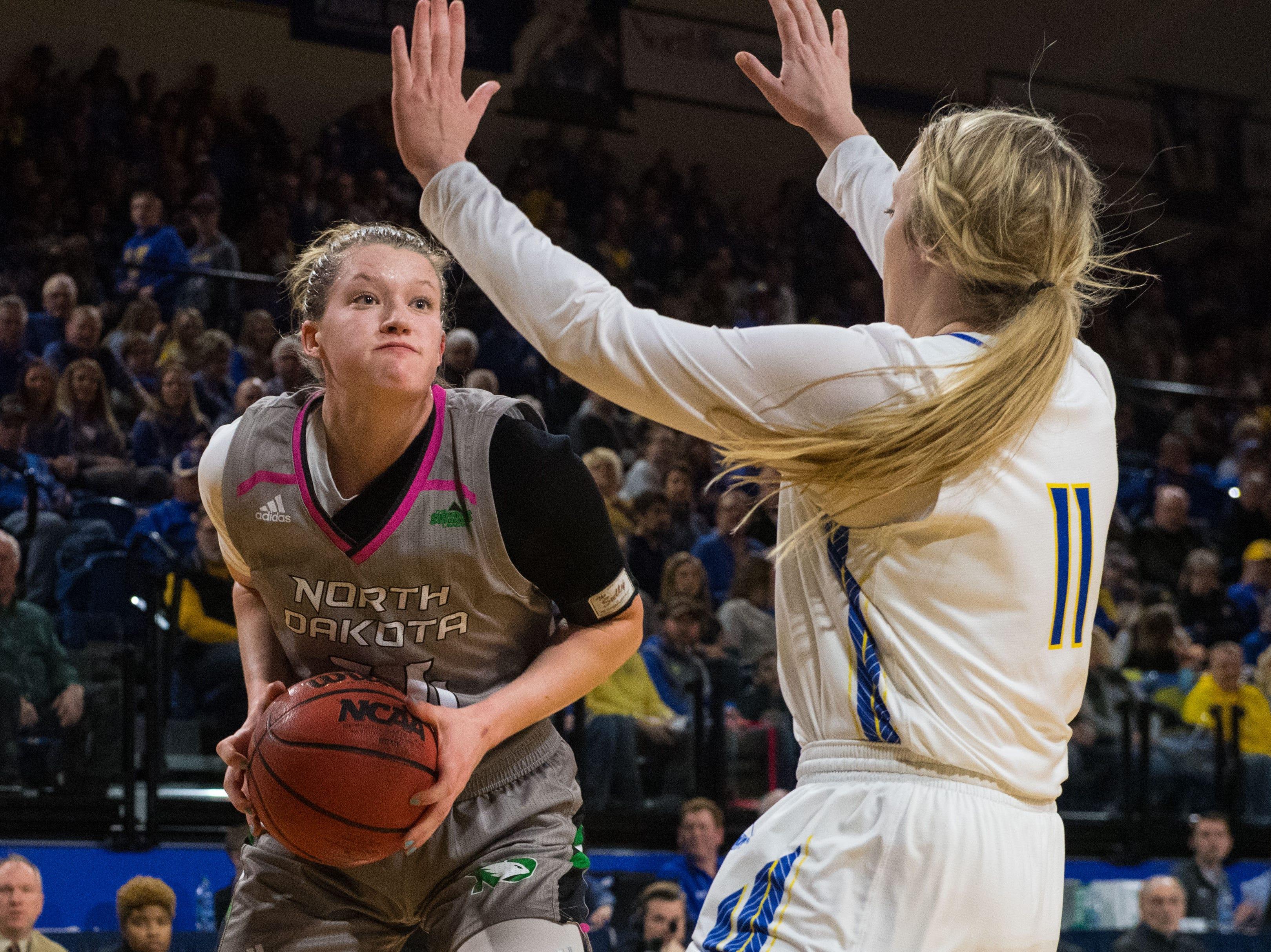 South Dakota State's Madison Guebert (11) blocks North Dakota's Lexi Klabo (34) during a game in Brookings, S.D., Saturday, Feb. 9, 2019.