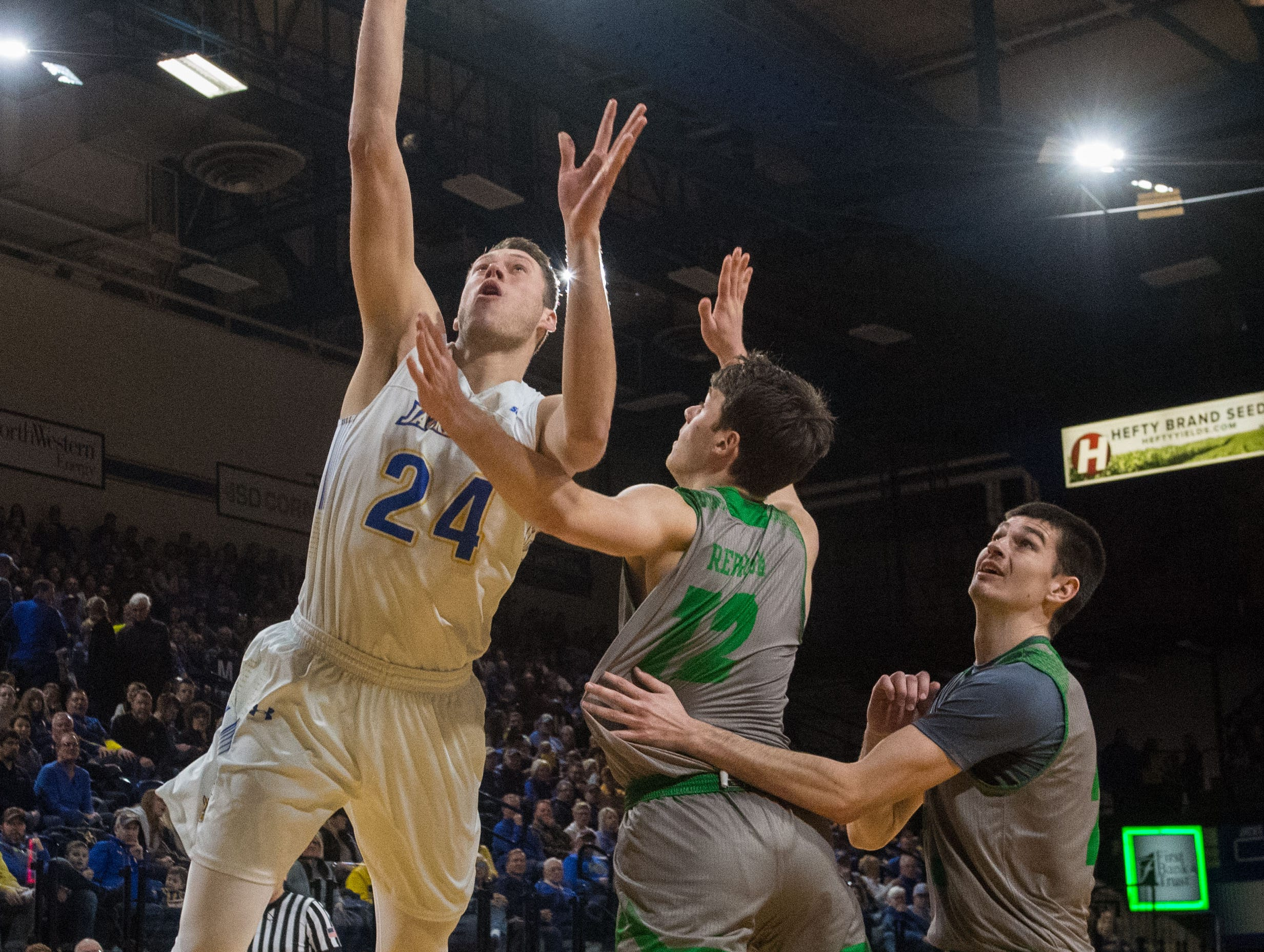 South Dakota State's Mike Daum (24) shoots the ball during a game against North Dakota in Brookings, S.D., Saturday, Feb. 9, 2019.