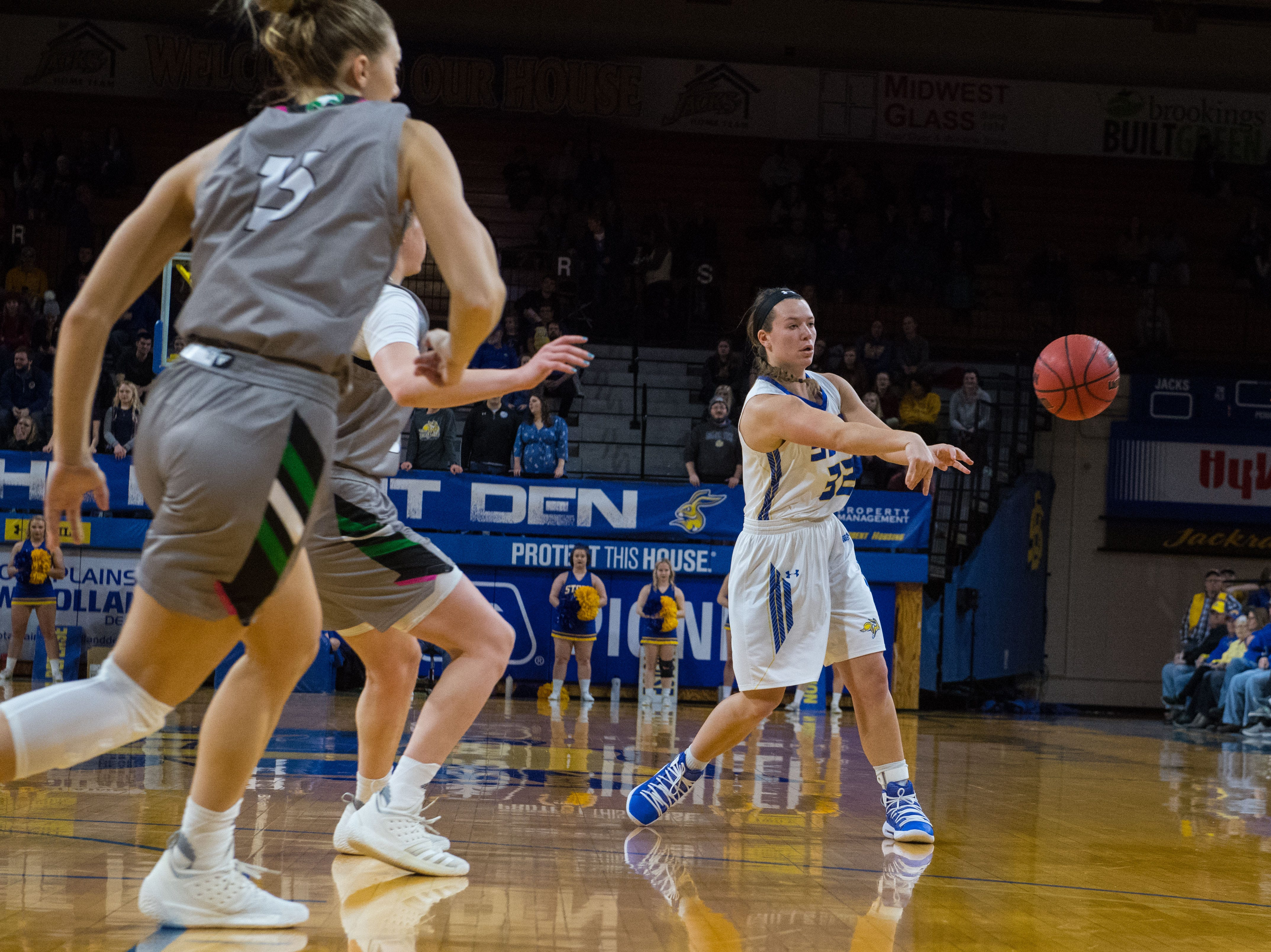 South Dakota State's Sydney Palmer (32) passes the ball during a game against North Dakota in Brookings, S.D., Saturday, Feb. 9, 2019.