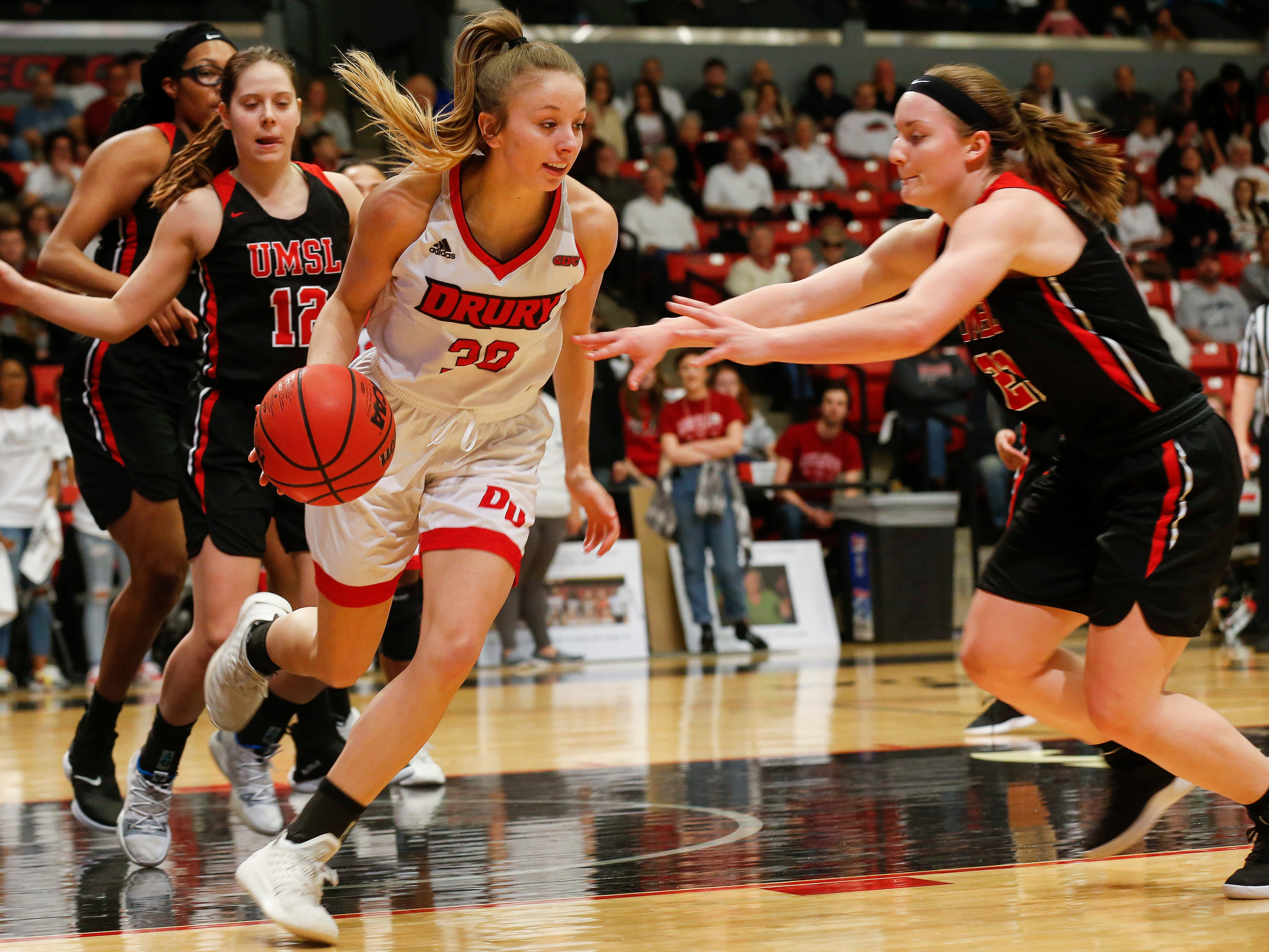 Brooke Stanfield, of Drury, dribbles the ball during the Lady Panthers' 77-44 win over the University of Missouri St. Louis Tritons during the Overflow the O game at the O'Reilly Family Event Center on Saturday, Feb. 9, 2019.