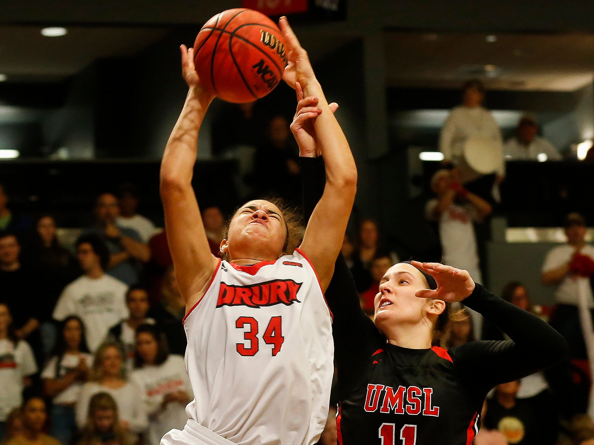 Hailey Diestelkamp, of Drury, is fouled by Alex LaPorta, of the University of Missouri St. Louis, during the Lady Panthers' 77-44 win over the Tritons  during the Overflow the O game at the O'Reilly Family Event Center on Saturday, Feb. 9, 2019.