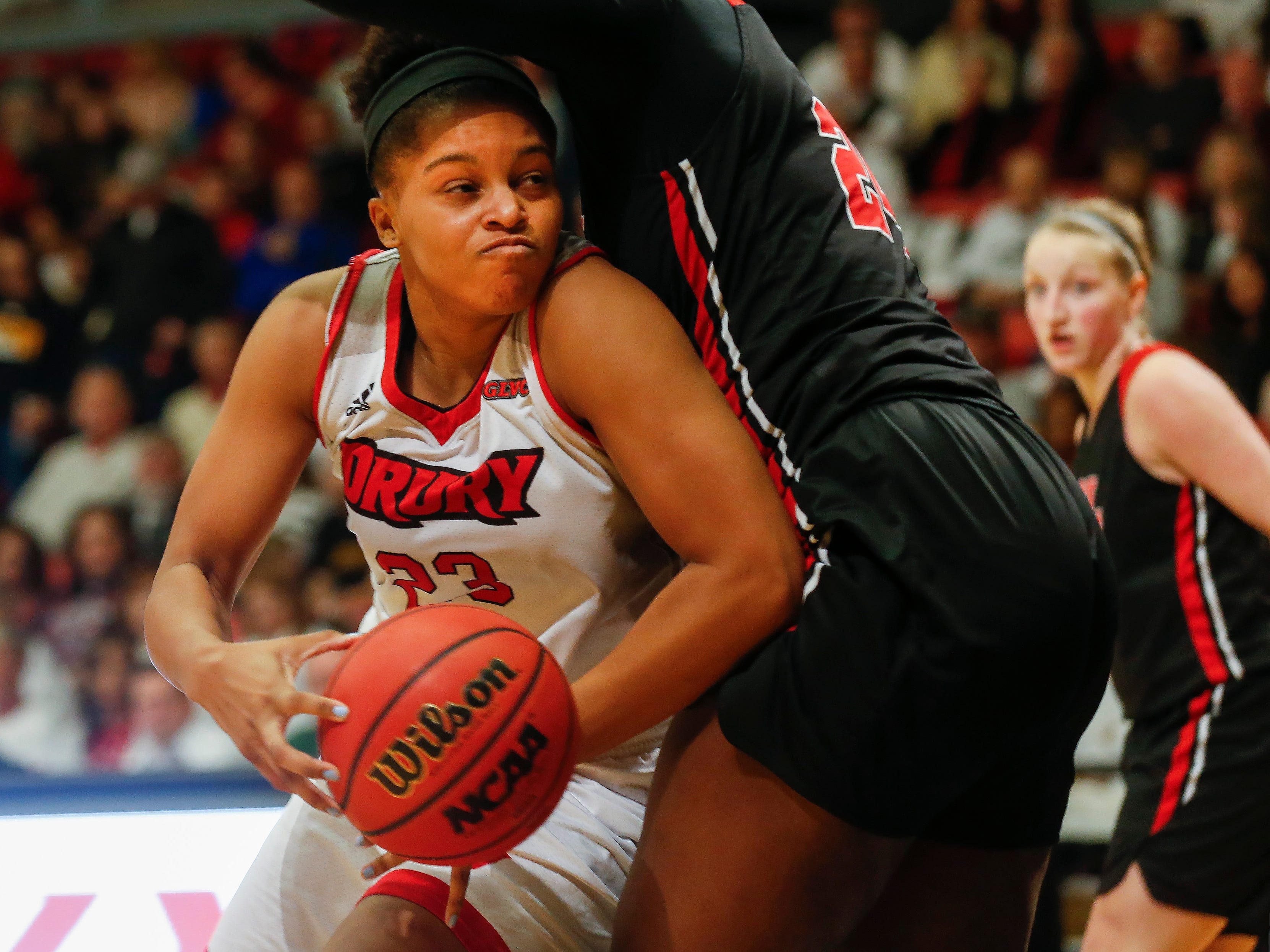 Azia Lynch, of Drury, moves around a defender during the Lady Panthers' 77-44 win over the University of Missouri St. Louis Tritons during the Overflow the O game at the O'Reilly Family Event Center on Saturday, Feb. 9, 2019.