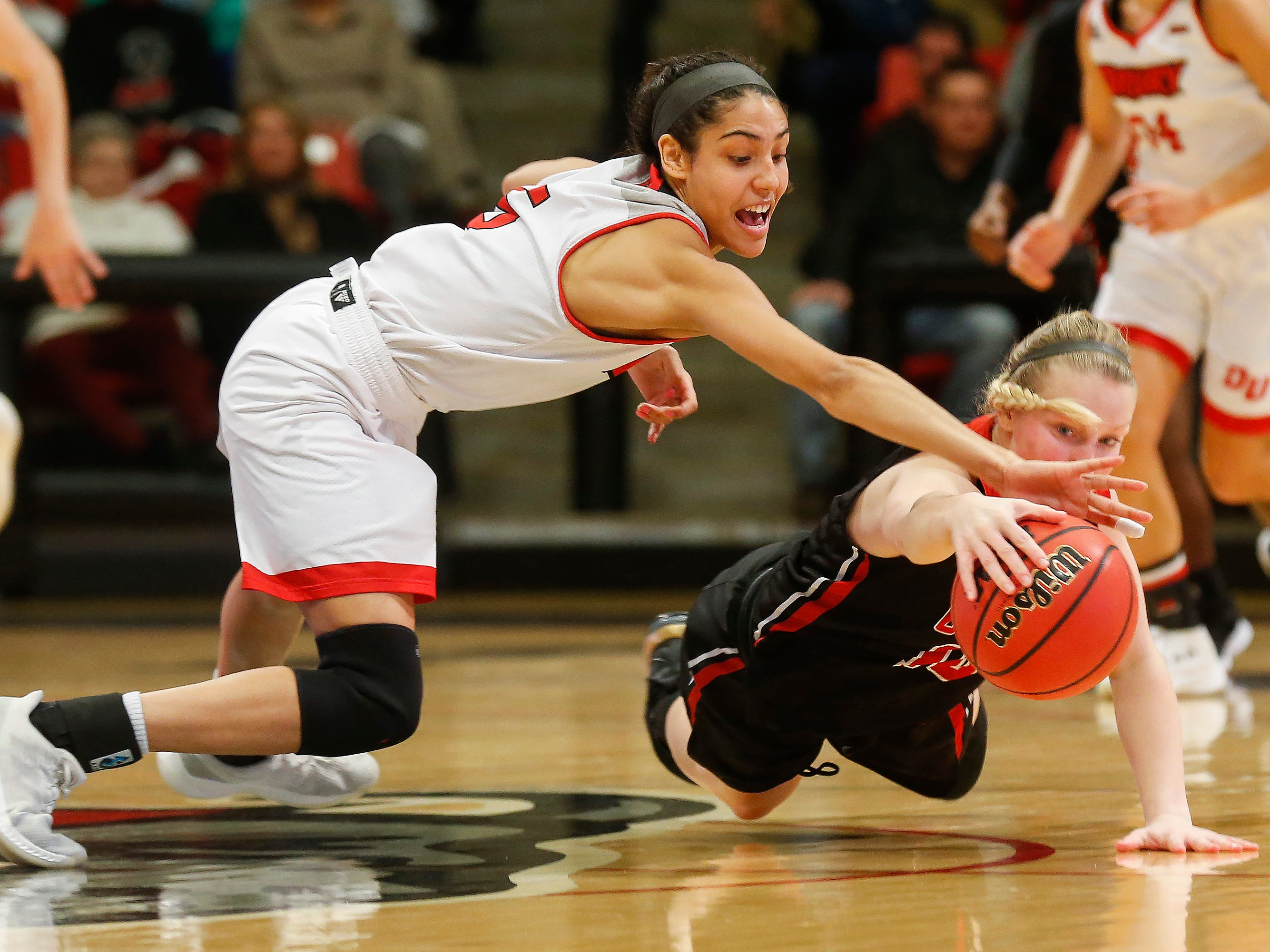 Daejah Bernard, of Drury, and Kaitlynn Henning Alex LaPorta, of the University of Missouri St. Louis, go after the loose ball during the Lady Panthers' 77-44 win over the Tritons during the Overflow the O game at the O'Reilly Family Event Center on Saturday, Feb. 9, 2019.