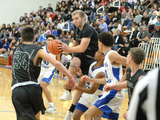 Wilson Memorial's Matt Poole pulls down a rebound Friday night in the quarterfinal round of the Shenandoah District boys basketball tournament.