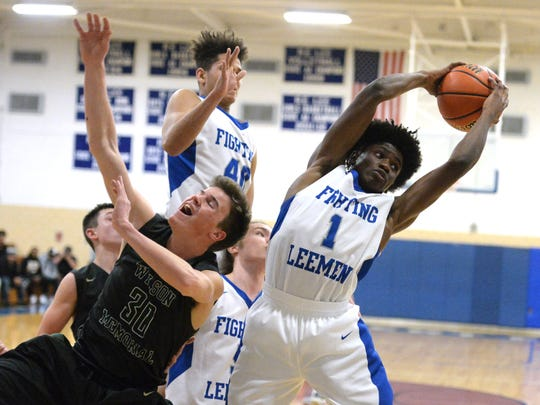 Lee High's Javon Battle pulls down a rebound Friday night in the quarterfinal round of the Shenandoah District boys basketball tournament.