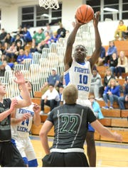Lee High's Kaleb Hall shoots over the Wilson defense Friday night in the quarterfinal round of the Shenandoah District boys basketball tournament.