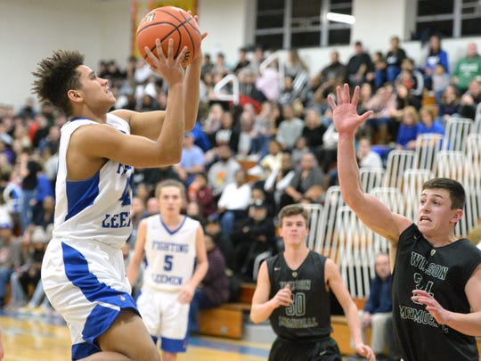 Lee High's Ethan Vest puts up a shot Friday night in the quarterfinal round of the Shenandoah District boys basketball tournament.